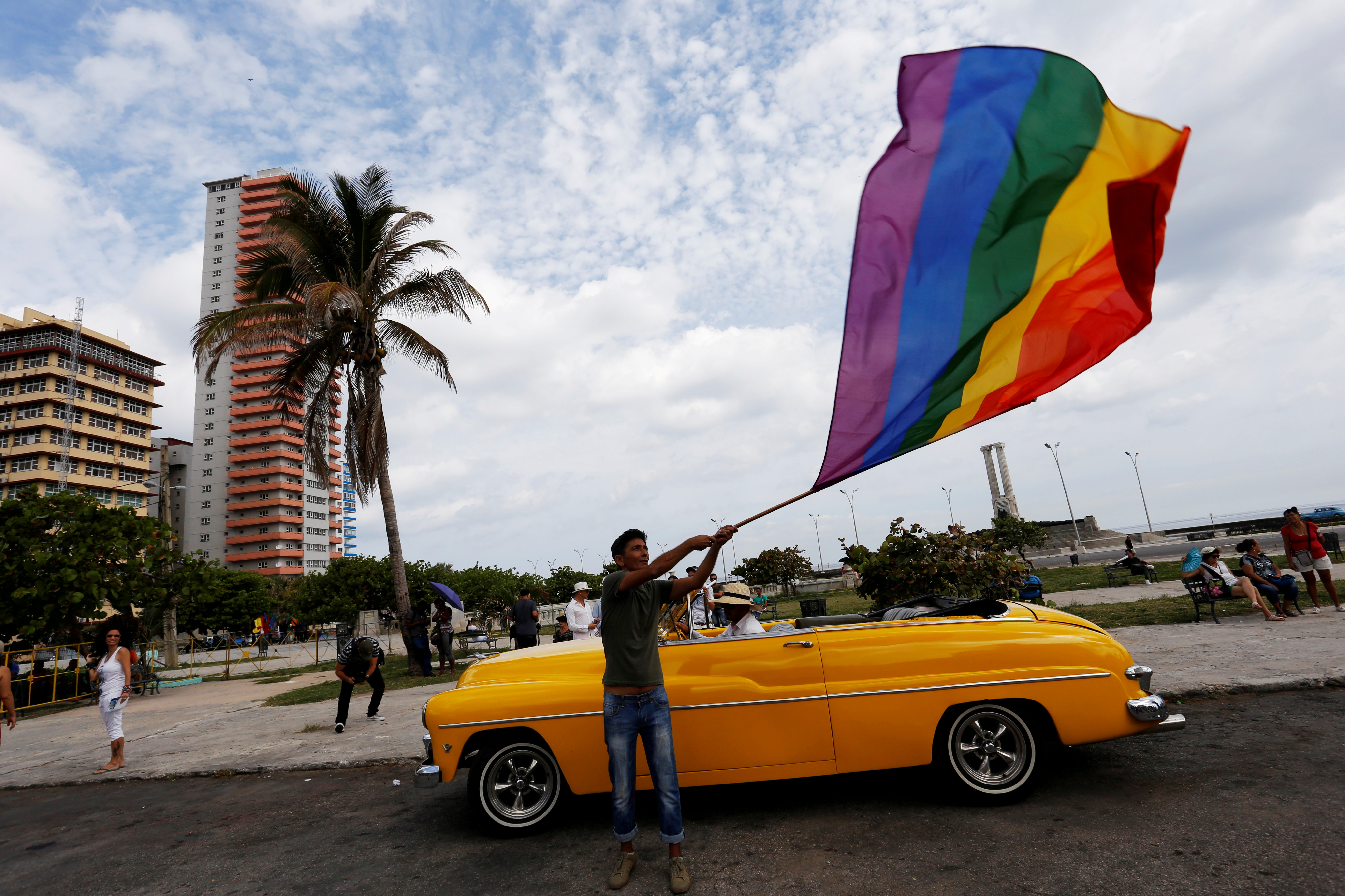 Participant waves a rainbow flag during the annual March against Homophobia and Transphobia in Havana, Cuba May 13, 2017.  REUTERS/Stringer