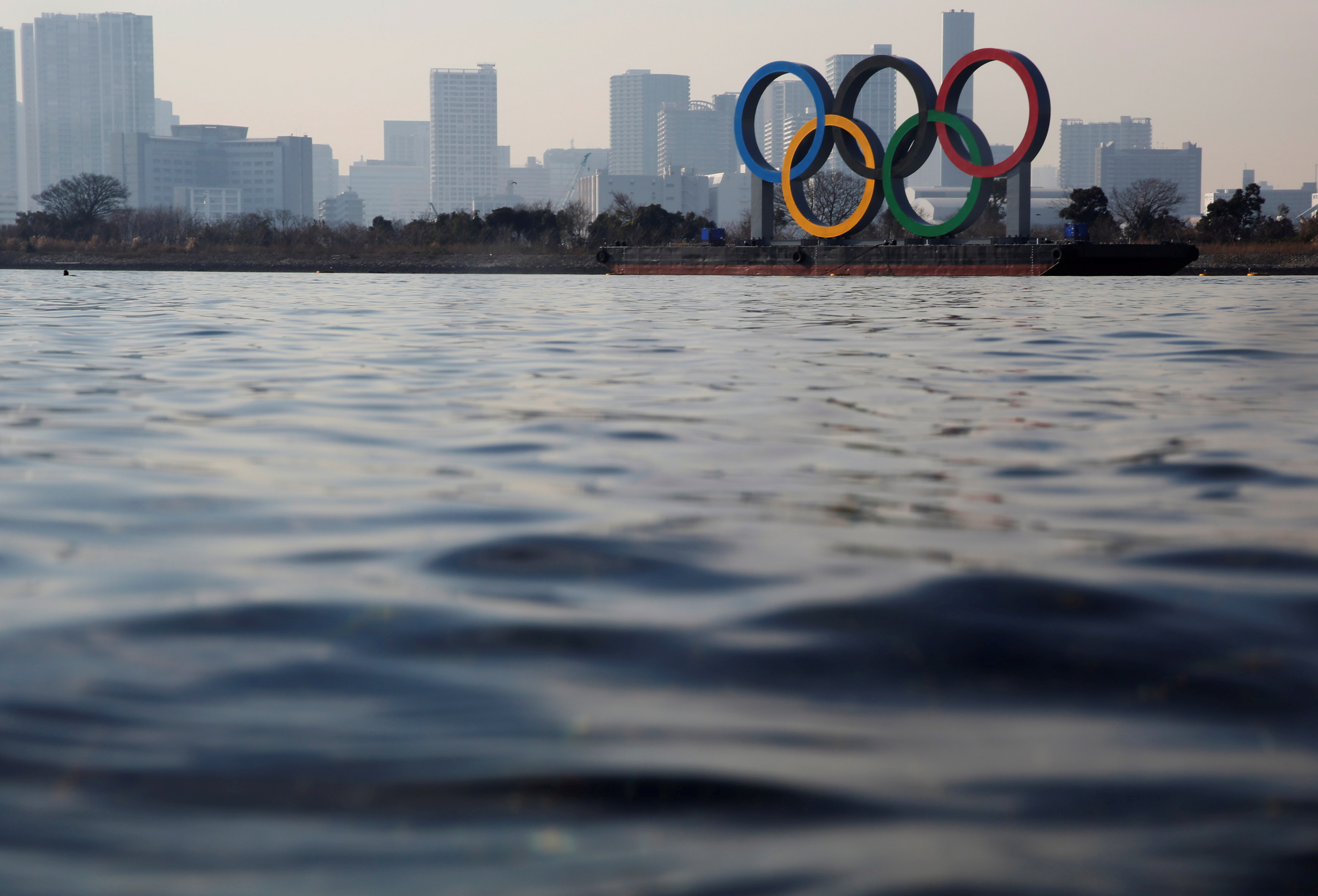 The giant Olympic rings are seen over the sea, amid the coronavirus disease (COVID-19) outbreak, in Tokyo, Japan, January 22, 2021. REUTERS/Kim Kyung-Hoon/File Photo