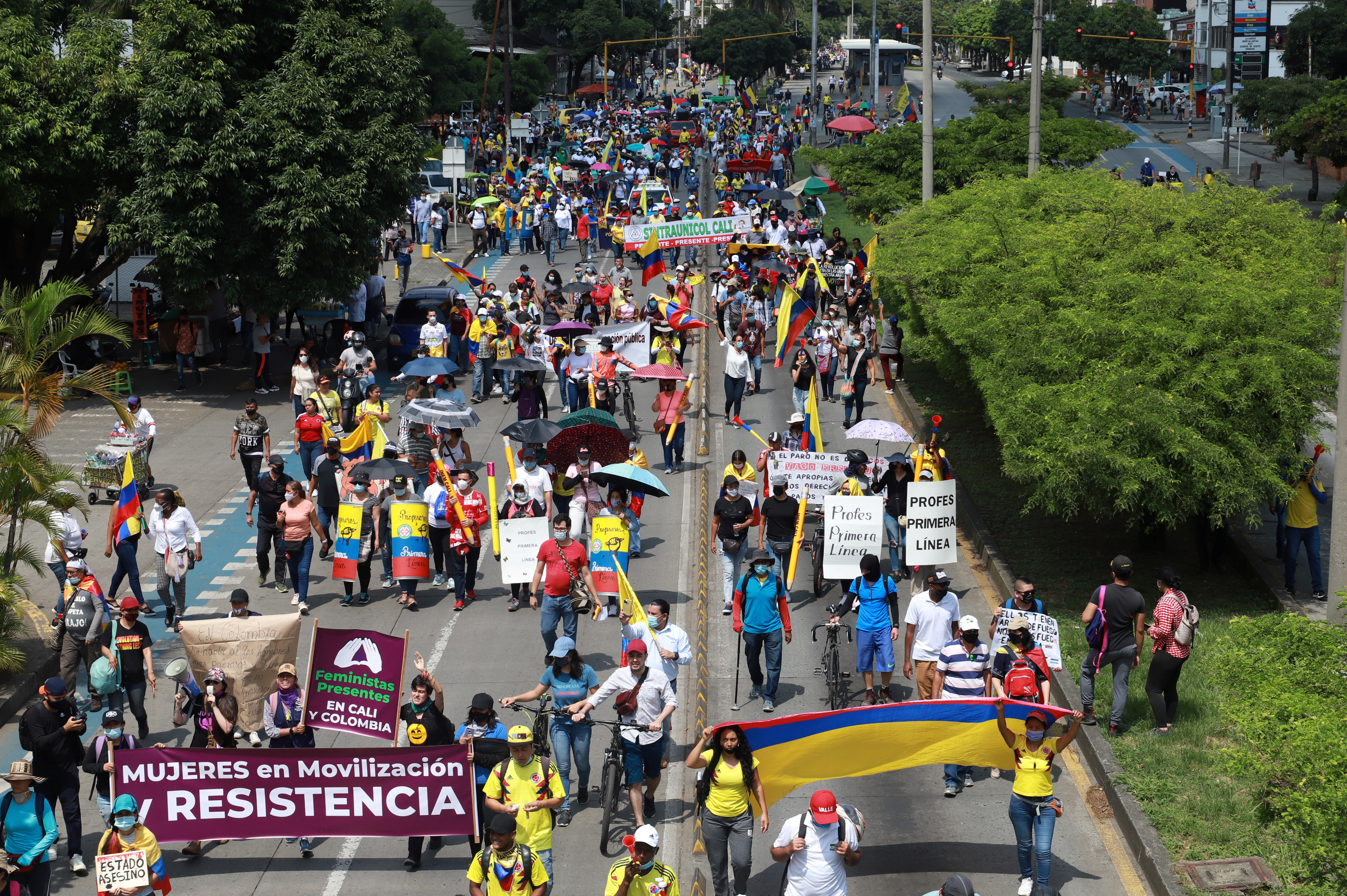 Demonstrators march during a protest demanding government action to tackle poverty, police violence and inequalities in healthcare and education systems, in Cali, Colombia June 2, 2021. REUTERS/Juan B Diaz