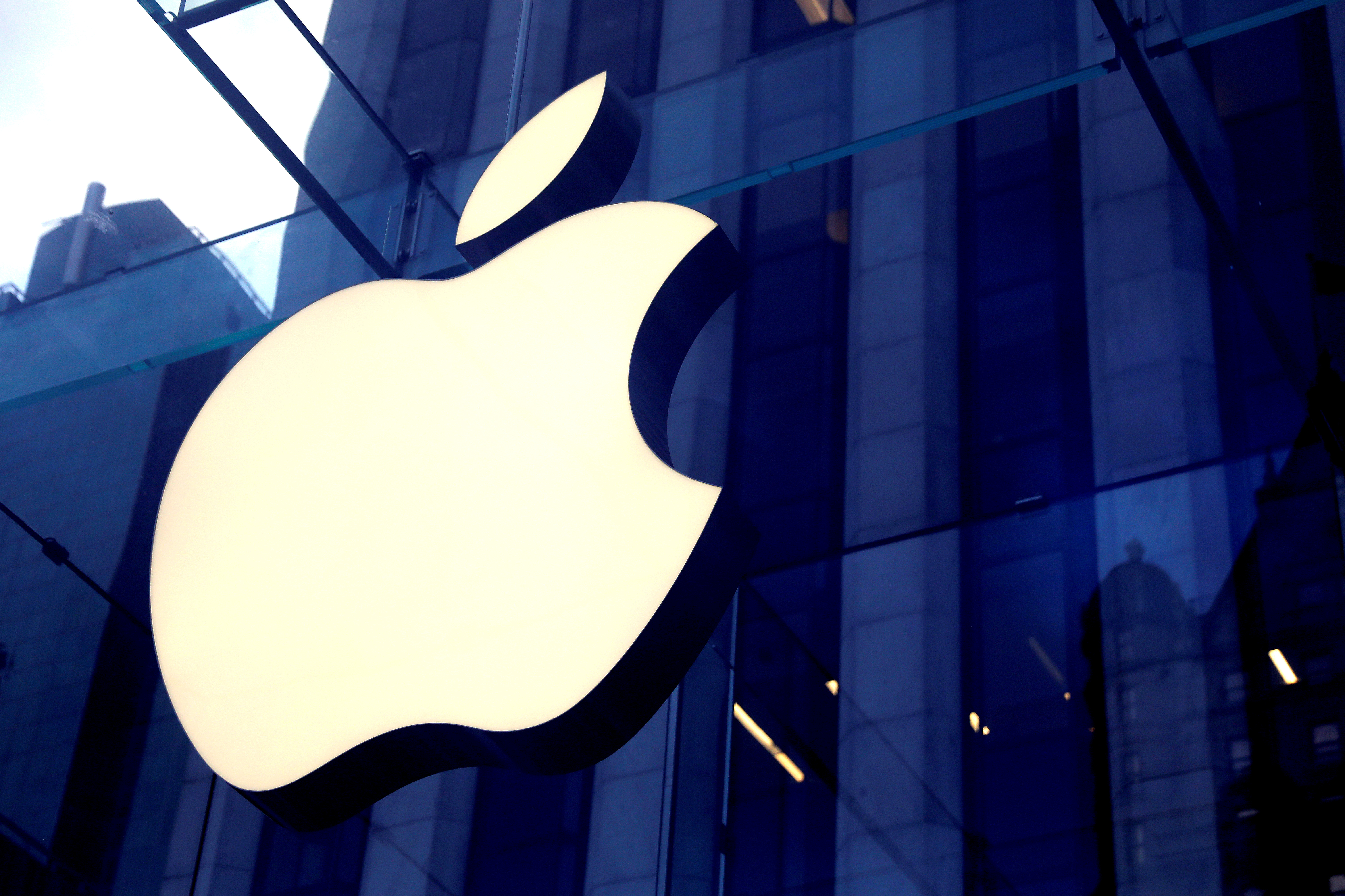 The Apple Inc logo is seen hanging at the entrance to the Apple store on 5th Avenue in Manhattan, New York, U.S., October 16, 2019. REUTERS/Mike Segar/File Photo/File Photo