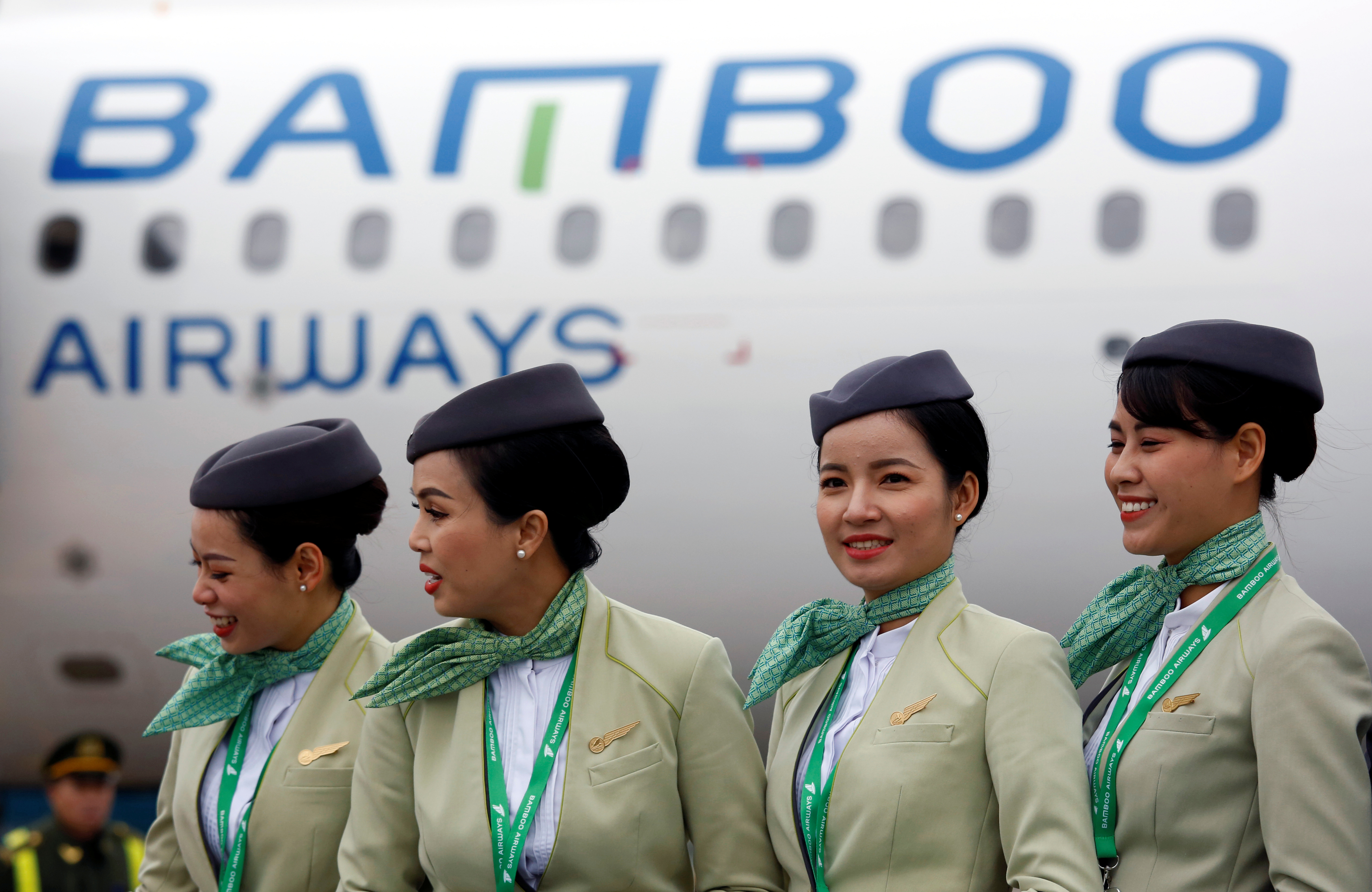 Crew members stand near an Airbus A321 aircraft of Bamboo Airways before a flight at Noi Bai airport in Hanoi, Vietnam January 16, 2019. REUTERS/Kham