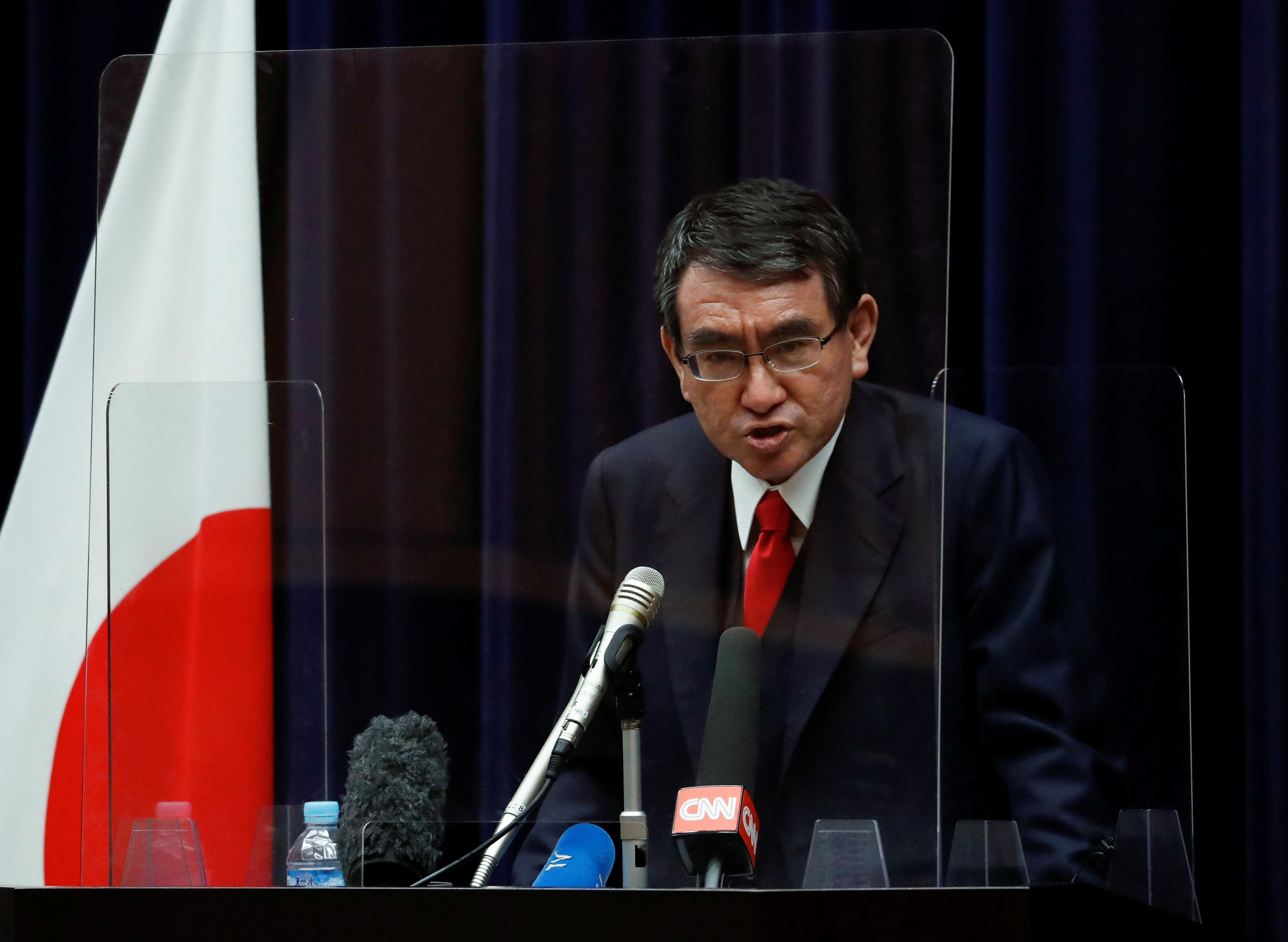 Japan's vaccination programme chief Taro Kono attends a news conference on the country's preparations to begin vaccinating health workers, amid the coronavirus disease (COVID-19) outbreak, in Tokyo, Japan February 16, 2021. REUTERS/Issei Kato