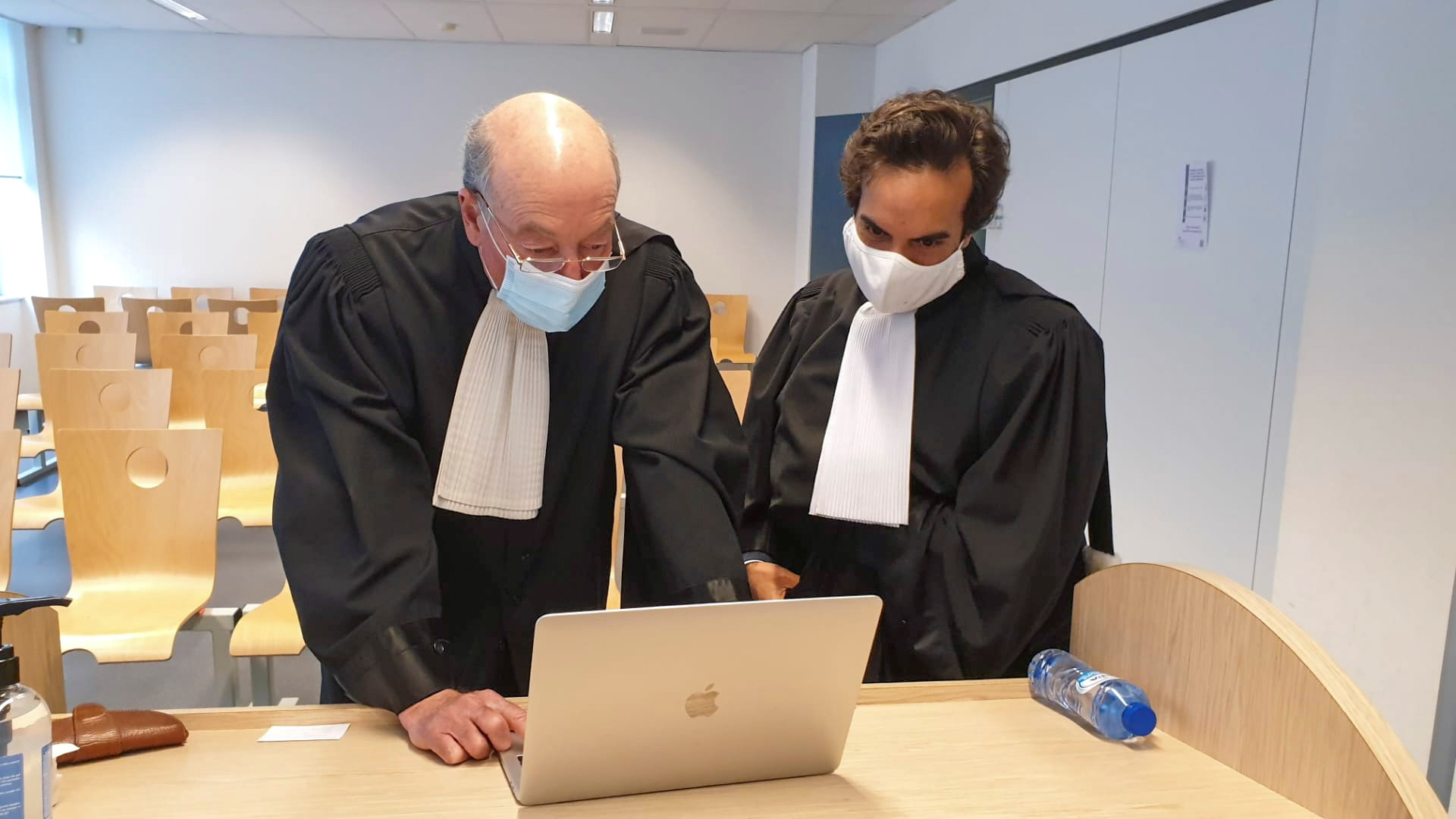 Lawyers for the European Commission, Paul Alain Foriers and Rafael Jafferali, attend the first hearing at a Belgian court in the legal case against the Anglo-Swedish firm AstraZeneca, accused by the EU of having breached its contract for the supply of COVID-19 vaccines, in Brussels, Belgium April 28, 2021. REUTERS/Clement Rossignol