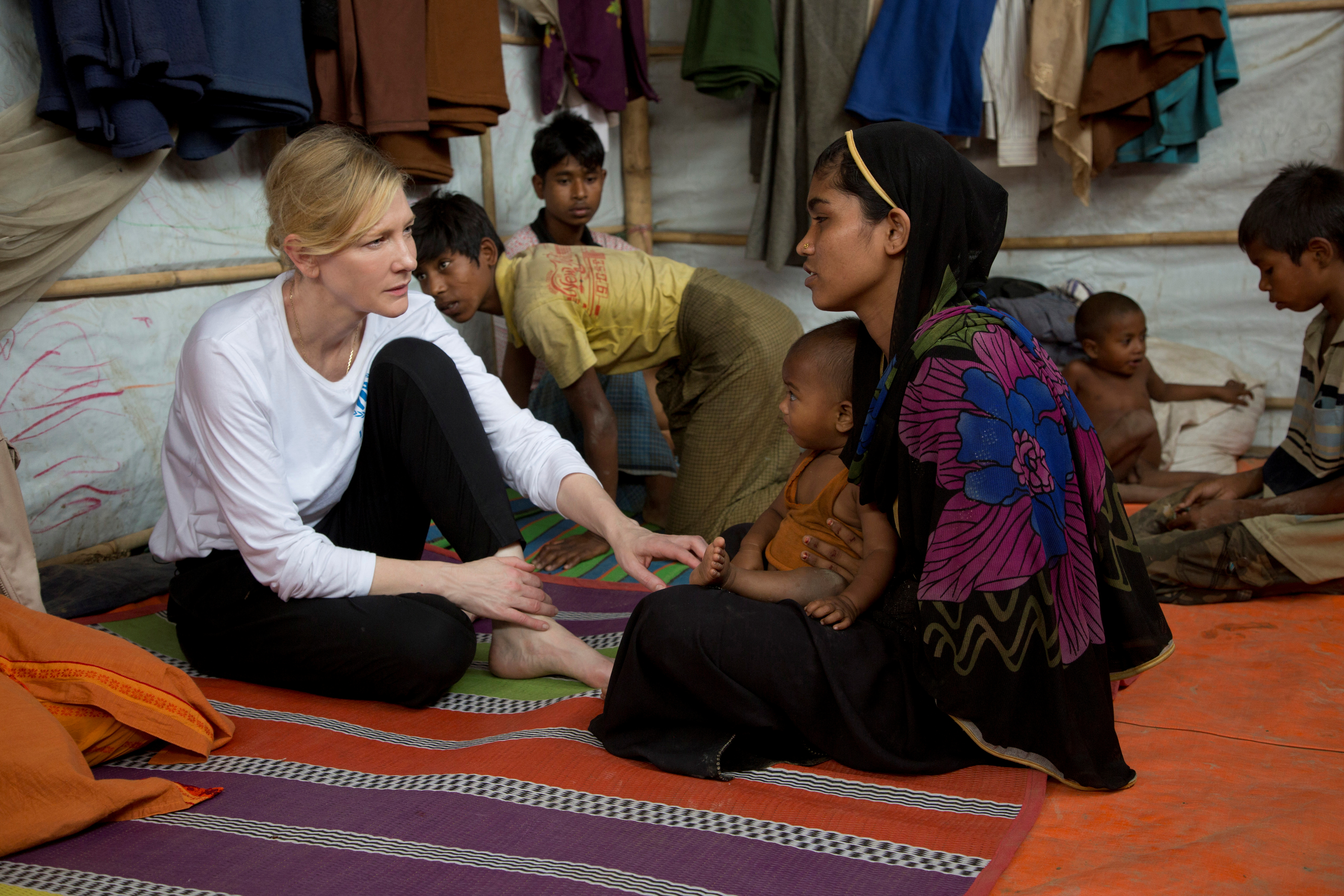 Cate Blanchett, Goodwill Ambassador for UNHCR, the UN Refugee Agency, speaks with Rohingya refugee Nur Fatima and her one-year-old son at the Nayapara refugee camp near Cox's Bazar, Bangladesh March 15, 2018. UNHCR/Hector Perez/Handout via REUTERS