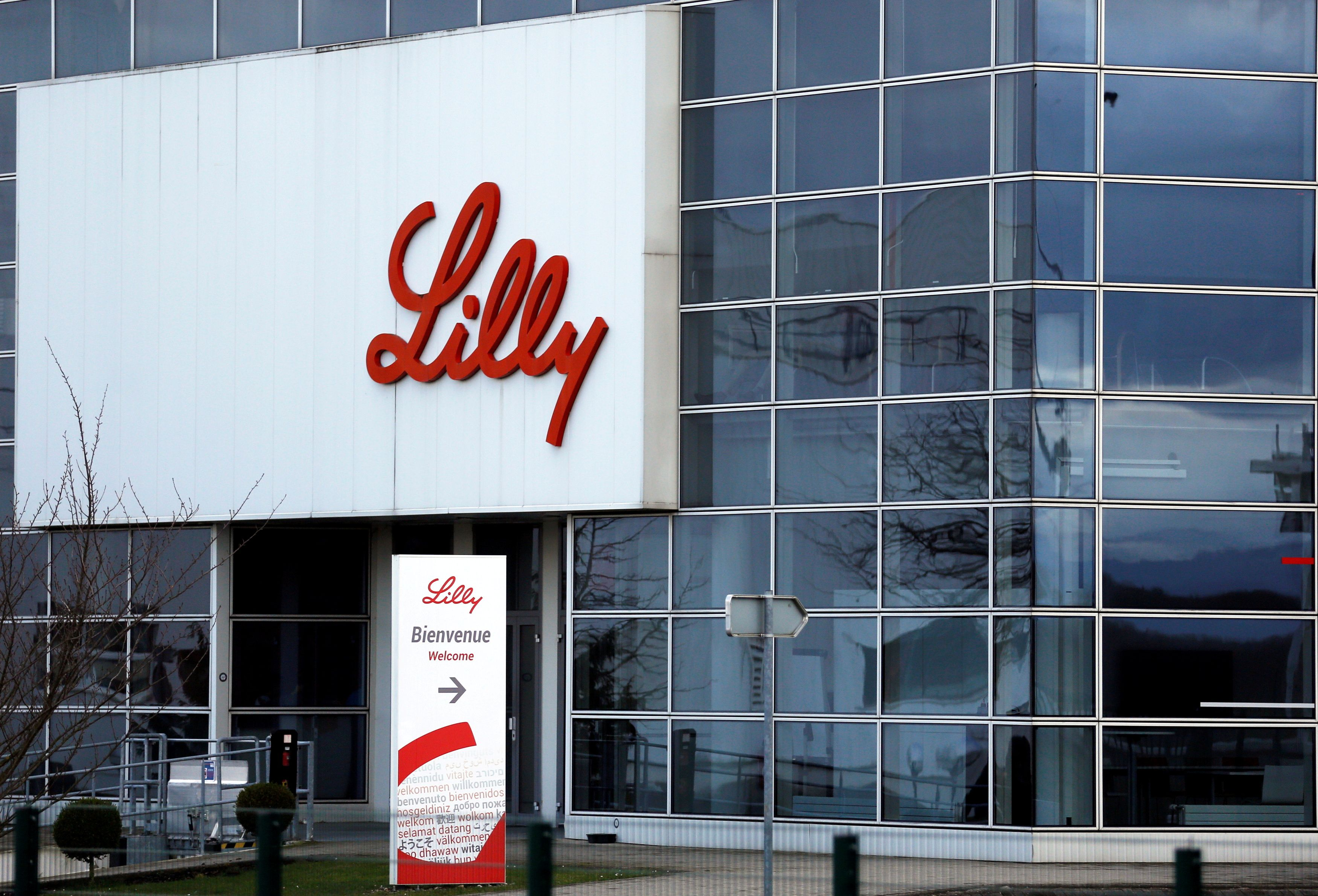 The logo of Lilly is seen on a wall of the Lilly France company unit, part of the Eli Lilly and Co drugmaker group, in Fegersheim near Strasbourg, France, February 1, 2018. REUTERS/Vincent Kessler/File Photo