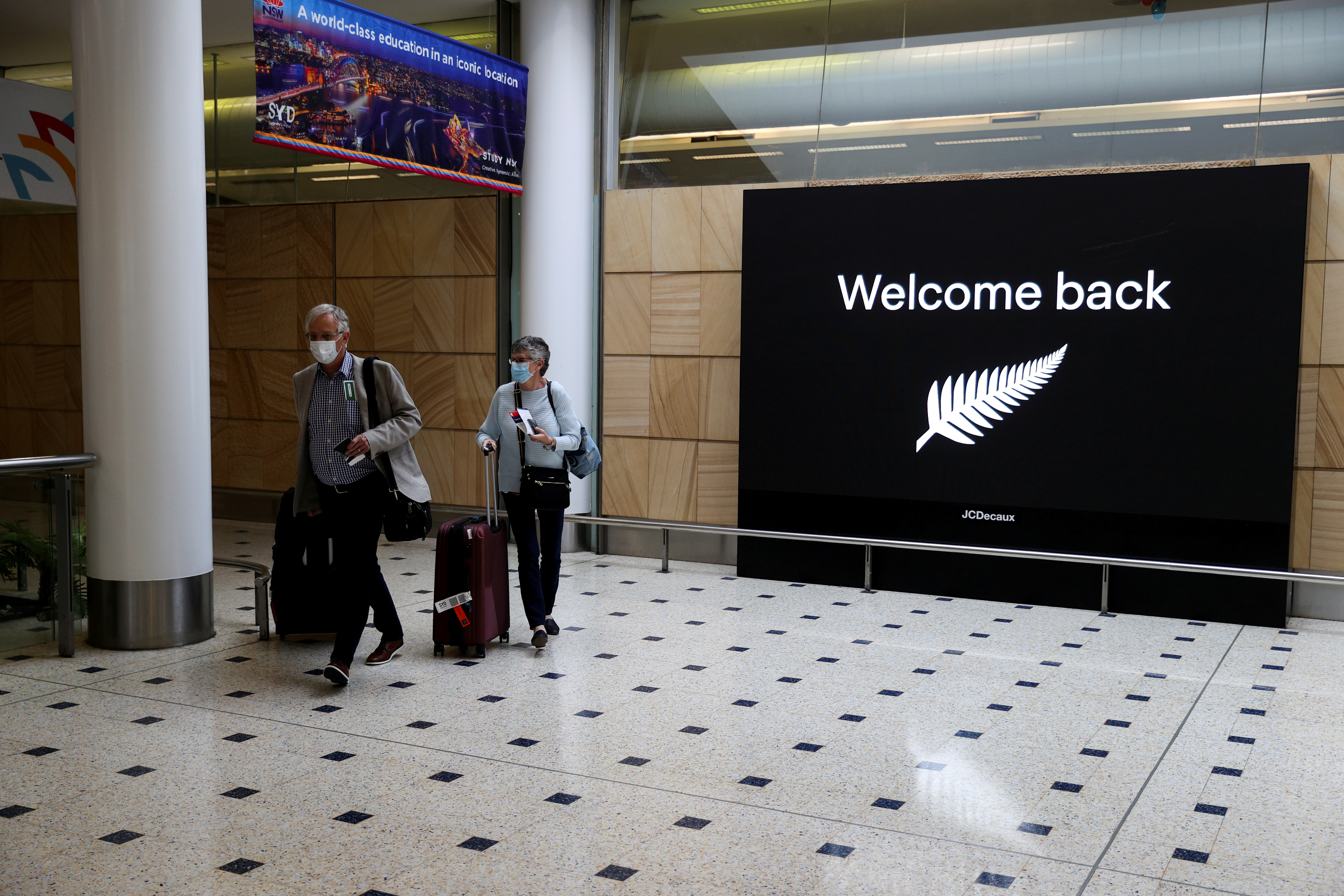 Passengers arrive from New Zealand after the Trans-Tasman travel bubble opened overnight, following an extended border closure due to the coronavirus disease (COVID-19) outbreak, at Sydney Airport in Sydney, Australia, October 16, 2020. REUTERS/Loren Elliott/File Photo
