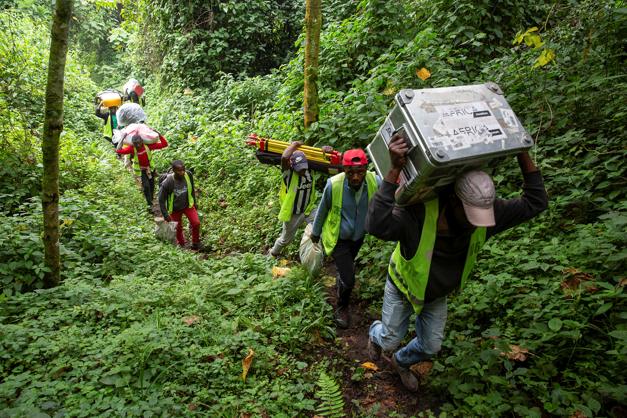 Congolese porters carry scientific equipment up Mount Nyiragongo volcano, inside the Virunga National Park, near Goma, in the eastern Democratic Republic of Congo February 11, 2021. REUTERS/Hereward Holland