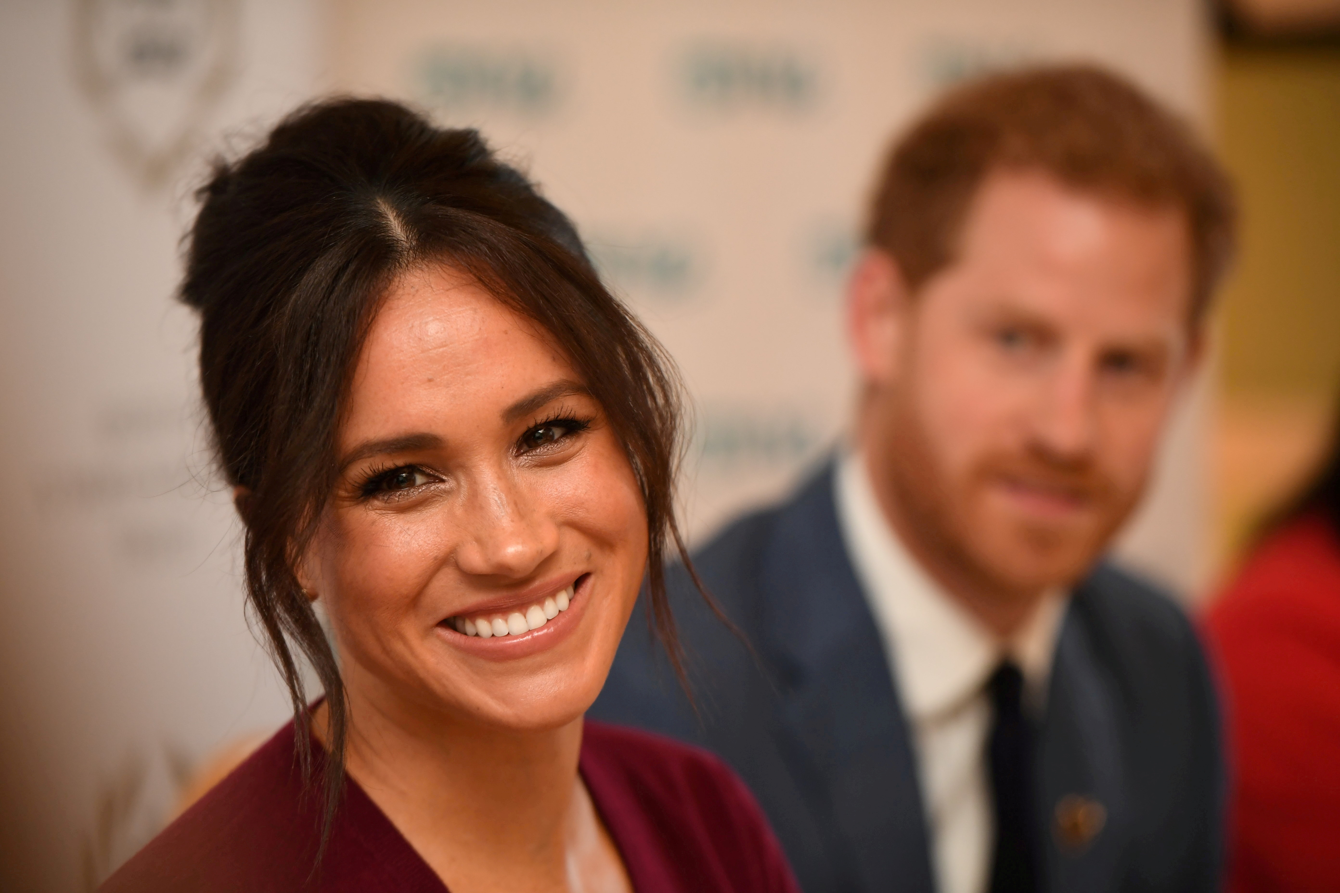 FILE PHOTO: Britain's Meghan, the Duchess of Sussex, and Prince Harry, Duke of Sussex, attend a roundtable discussion on gender equality at Windsor Castle, Windsor, Britain October 25, 2019. Jeremy Selwyn/Pool via Reuters/File Photo