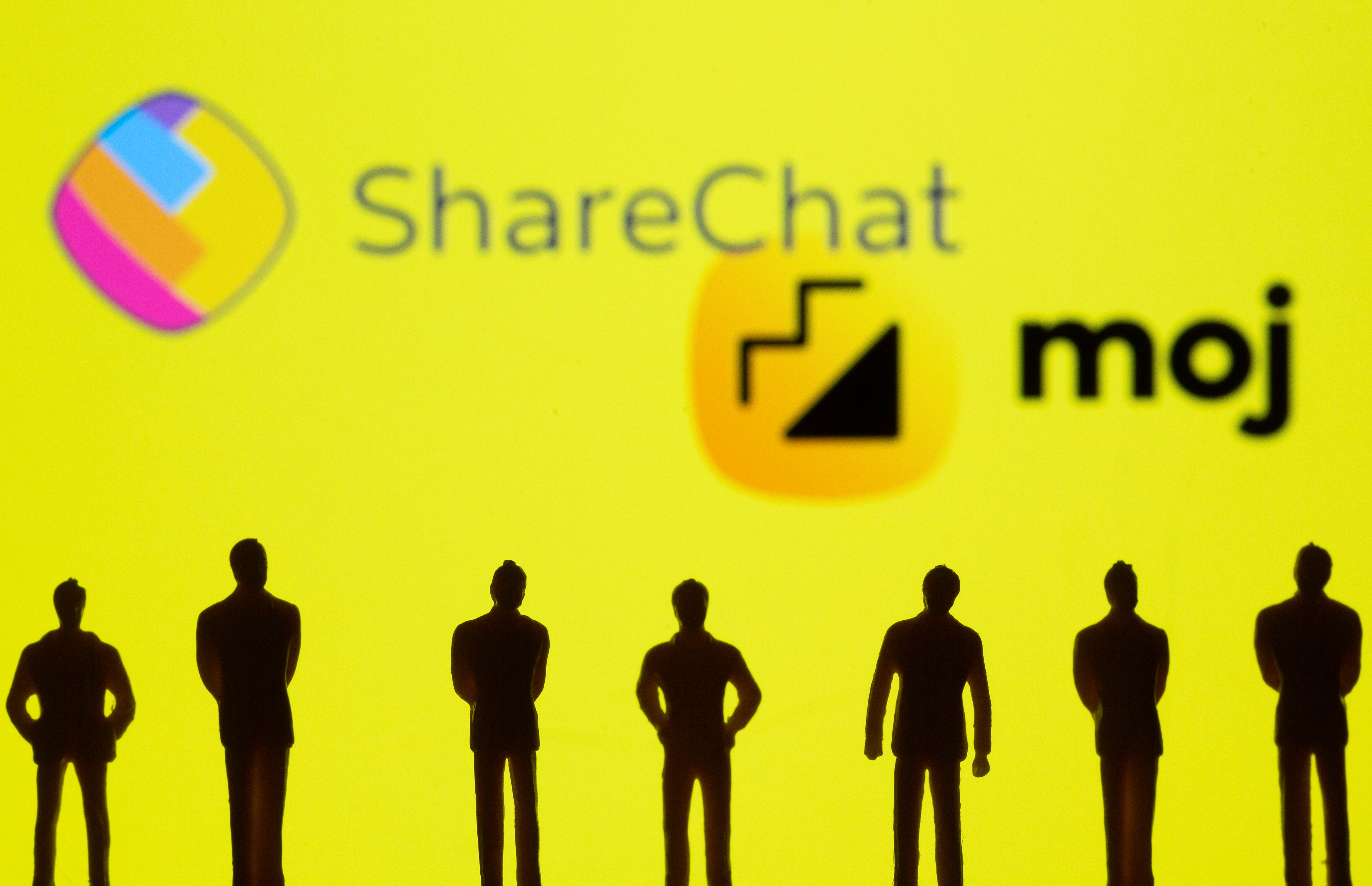 Small toy figures are seen in front of displayed ShareChat and Moj logo in this illustration taken, July 26, 2021. REUTERS/Dado Ruvic/Illustration