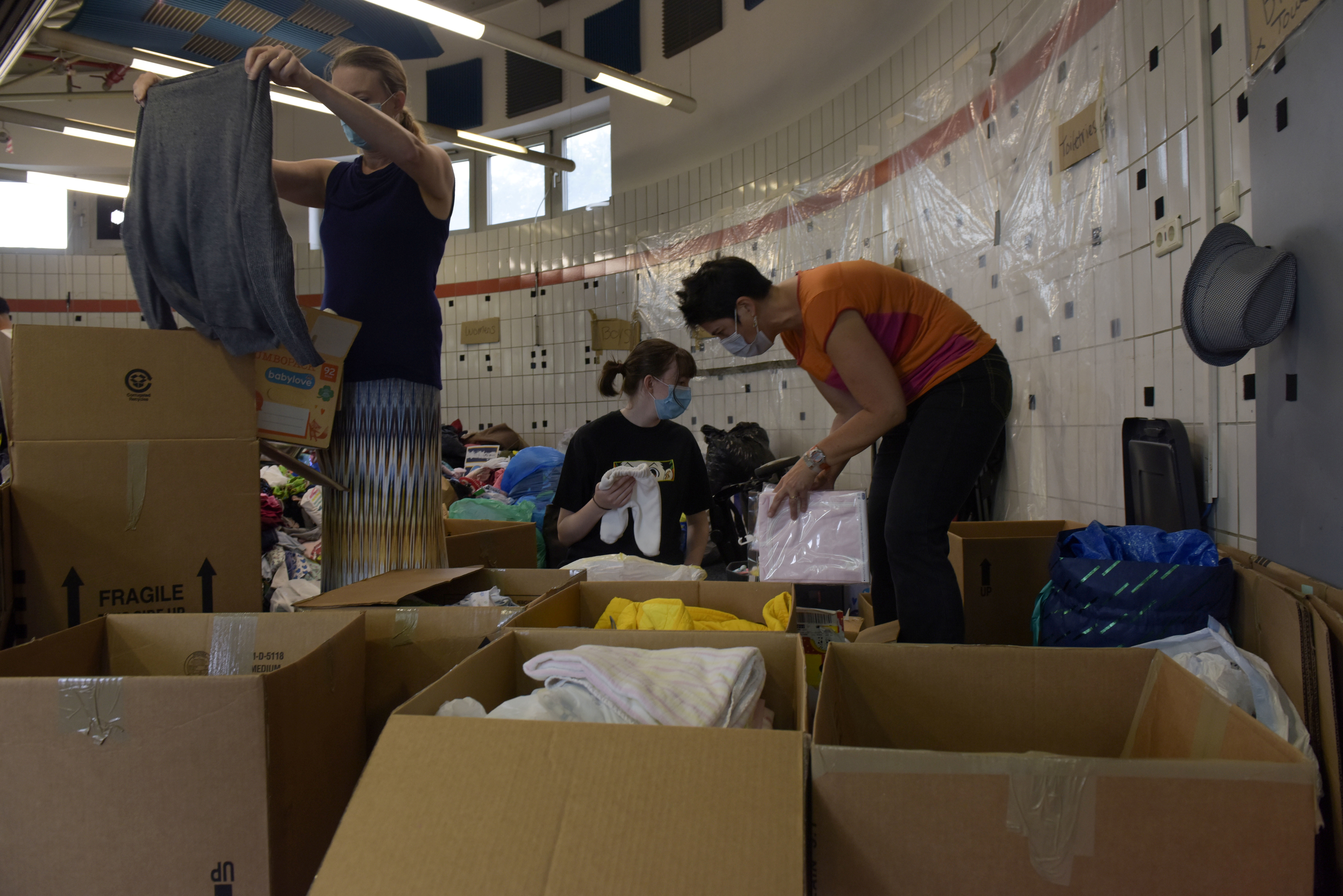 Civilian volunteers sort donations for evacuees from Afghanistan at Ramstein Air Base, Germany, August 22, 2021. Airman 1st Class Madelyn Keech/U.S. Air Force/Handout via REUTERS