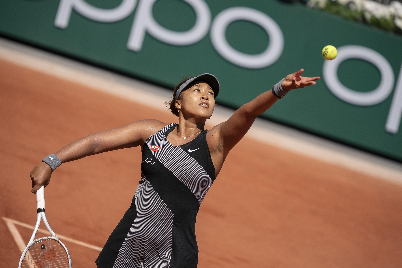 May 30, 2021; Paris, France; Naomi Osaka (JPN) in action during her match against Patricia Maria Tig (ROU) at Roland Garros Stadium. Mandatory Credit: Susan Mullane-USA TODAY Sports