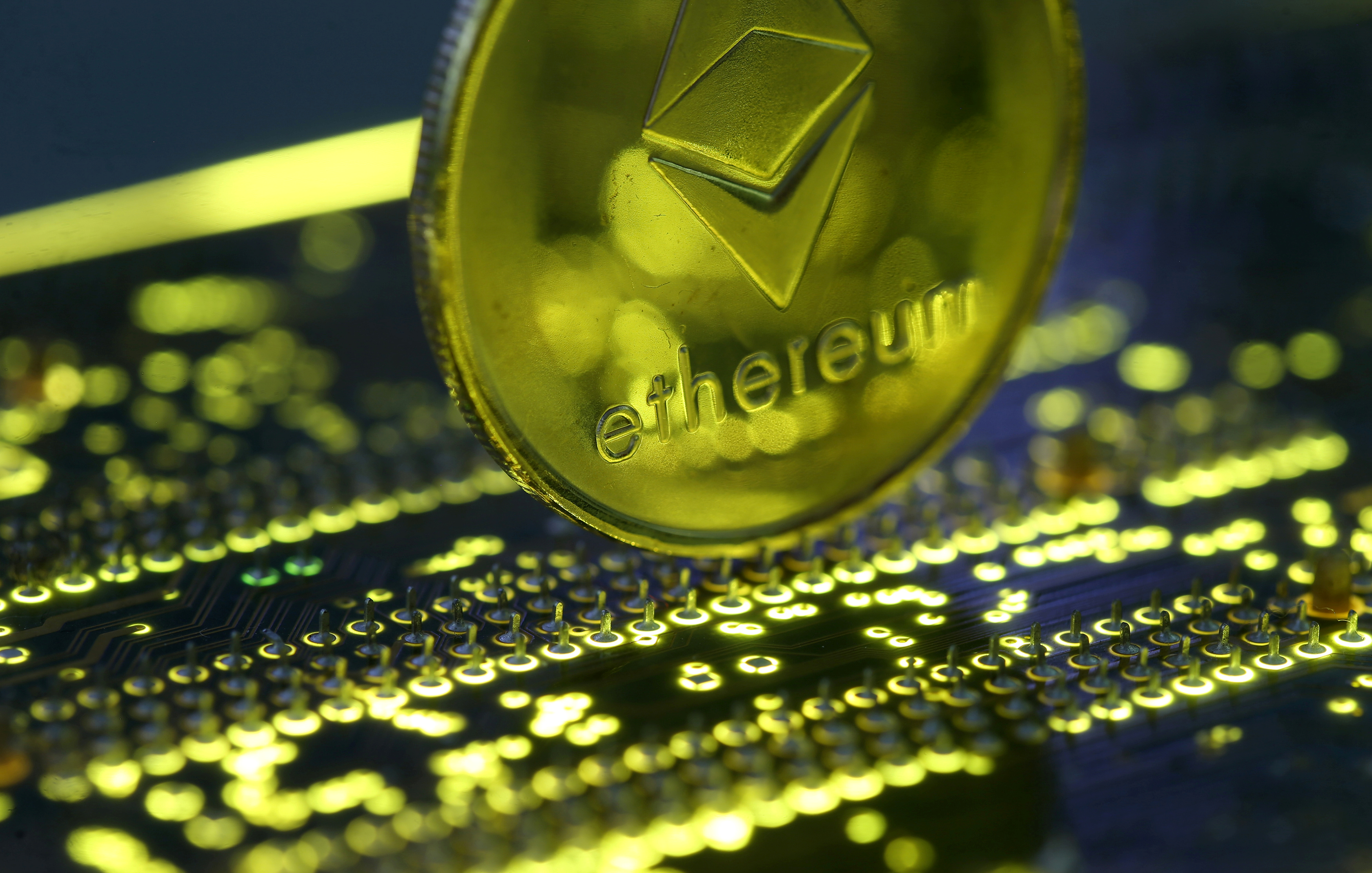 Representation of the Ethereum virtual currency standing on the PC motherboard is seen in this illustration picture, February 3, 2018. REUTERS/Dado Ruvic/Illustration/File Photo