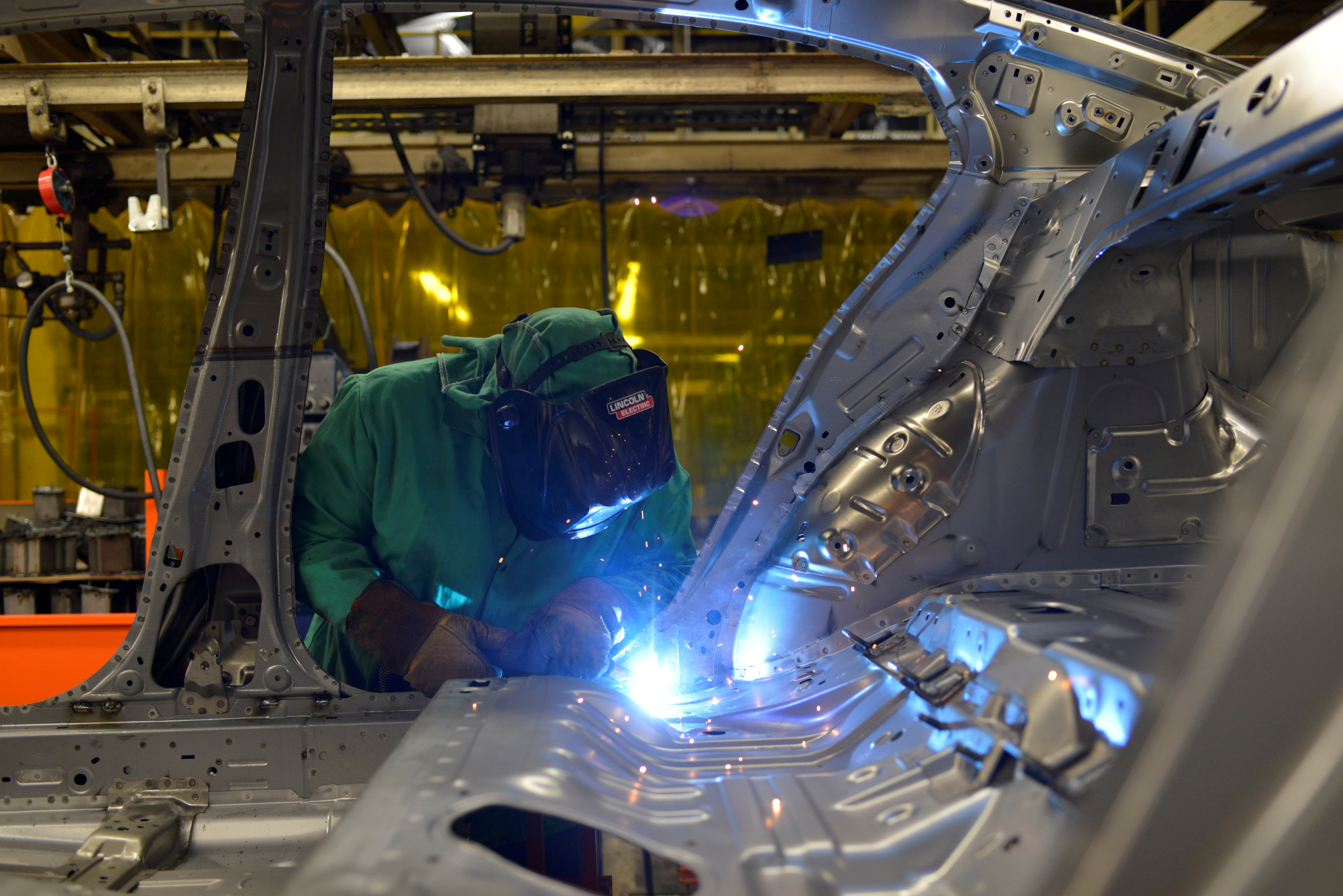 Line workers spot weld parts of the frame on the flex line at Nissan Motor Co's automobile manufacturing plant in Smyrna, Tennessee, U.S., August 23, 2018. REUTERS/William DeShazer/File Photo