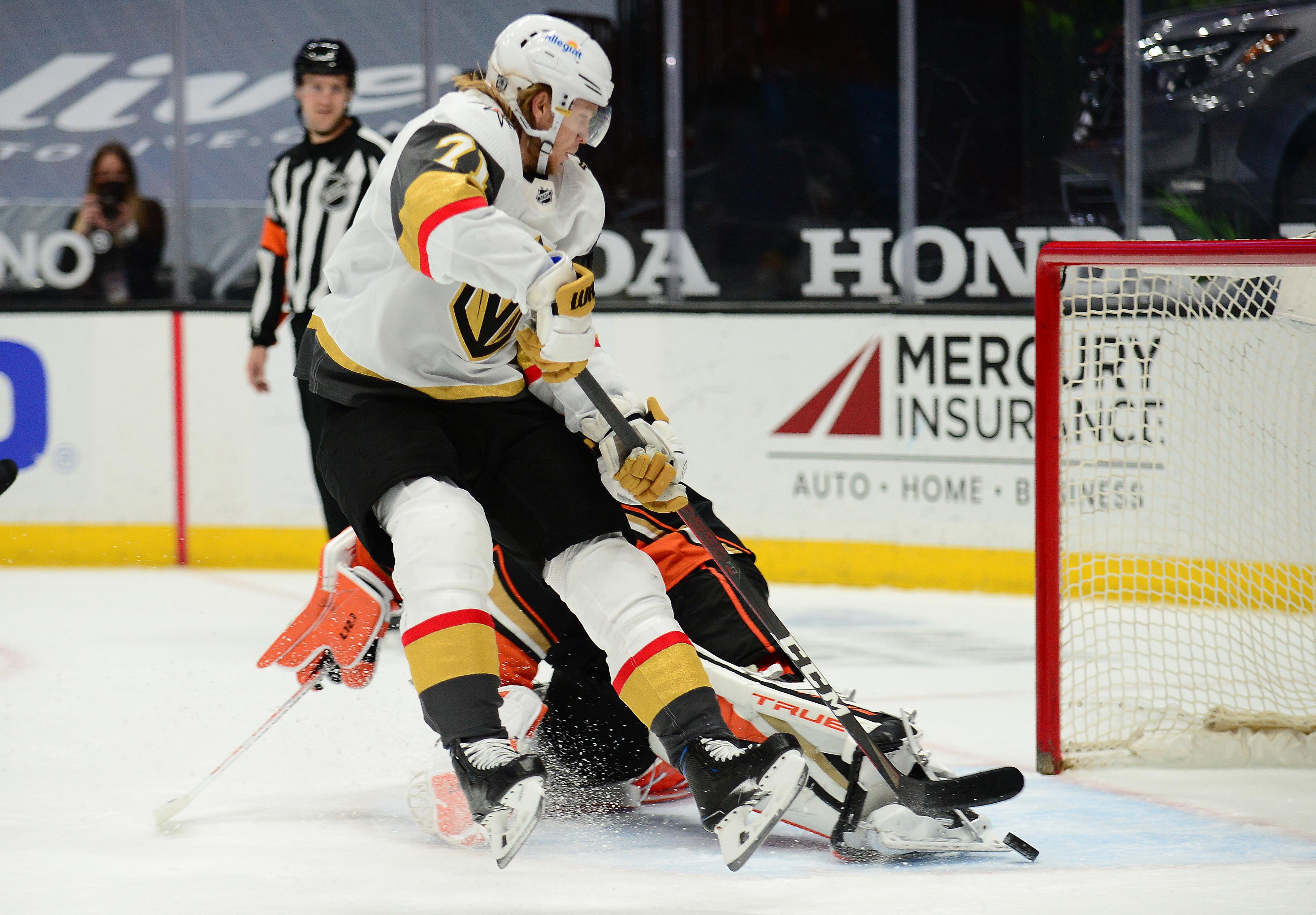 Feb 27, 2021; Anaheim, California, USA; Vegas Golden Knights center William Karlsson (71) scores a goal against Anaheim Ducks goaltender John Gibson (36) during overtime at Honda Center. Mandatory Credit: Gary A. Vasquez-USA TODAY Sports