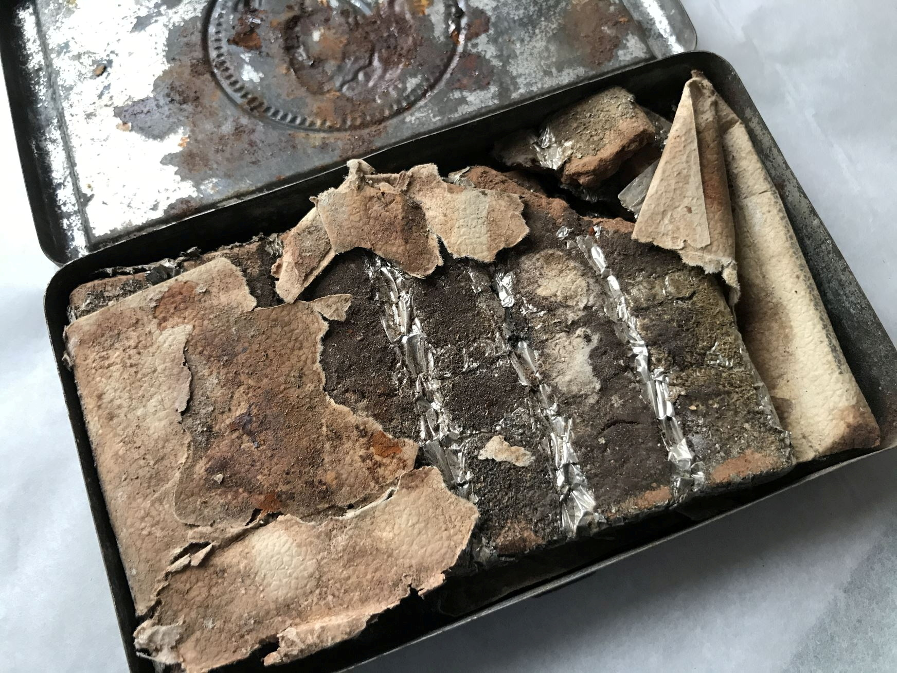 A 121-year-old chocolate bar from a batch commissioned by Queen Victoria for British troops fighting in South Africa is seen in an undated photo at Oxburgh Hall, a manor house in Norfolk, Britain where it was found in the attic. National Trust/Victoria McKeown/Handout via REUTERS  THIS IMAGE HAS BEEN SUPPLIED BY A THIRD PARTY. MANDATORY CREDIT. NO RESALES. NO ARCHIVES