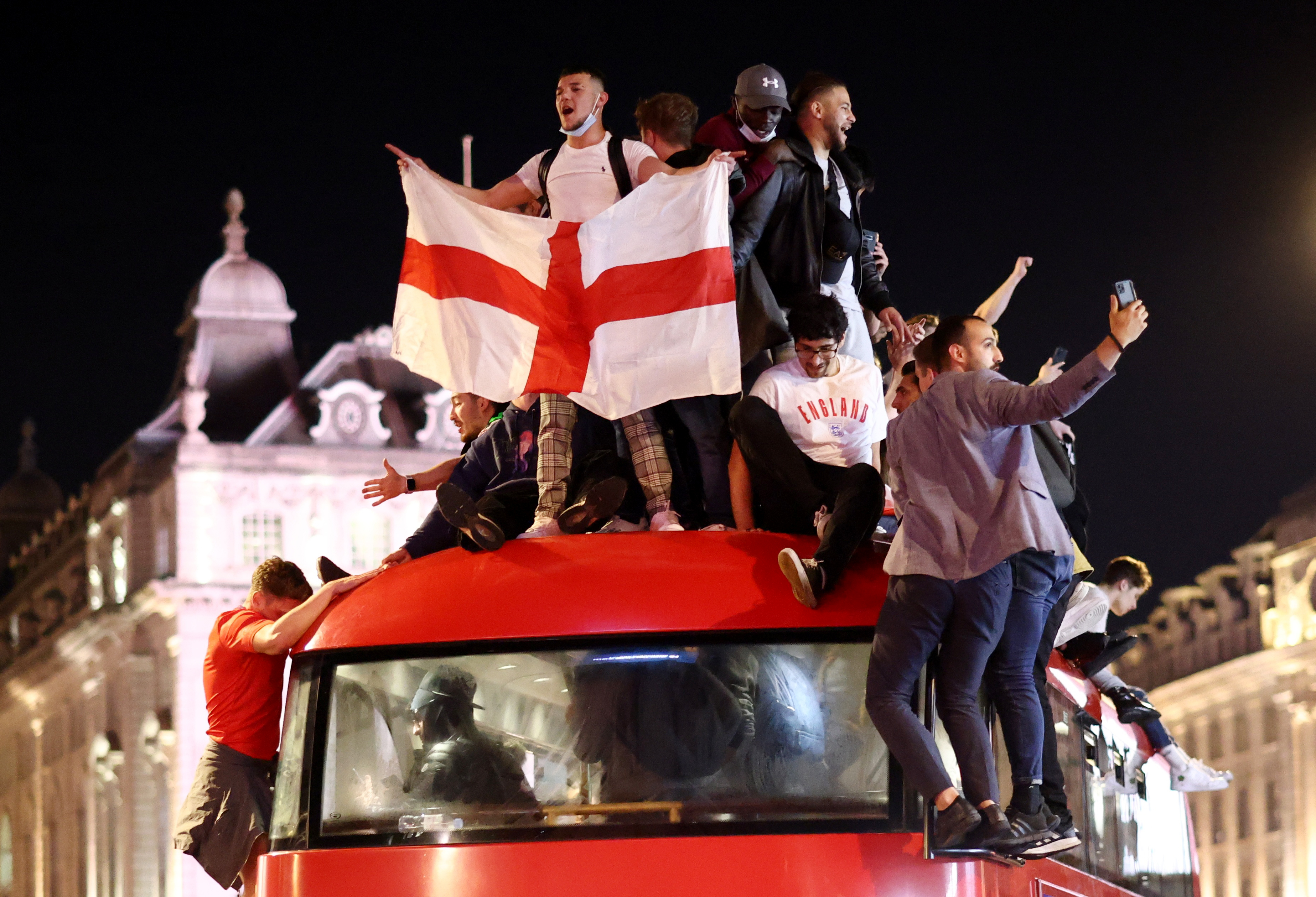 Soccer Football - Euro 2020 - Fans gather for England v Denmark - Piccadilly Circus, London, Britain - July 7, 2021 England fans celebrate after the match REUTERS/Henry Nicholls