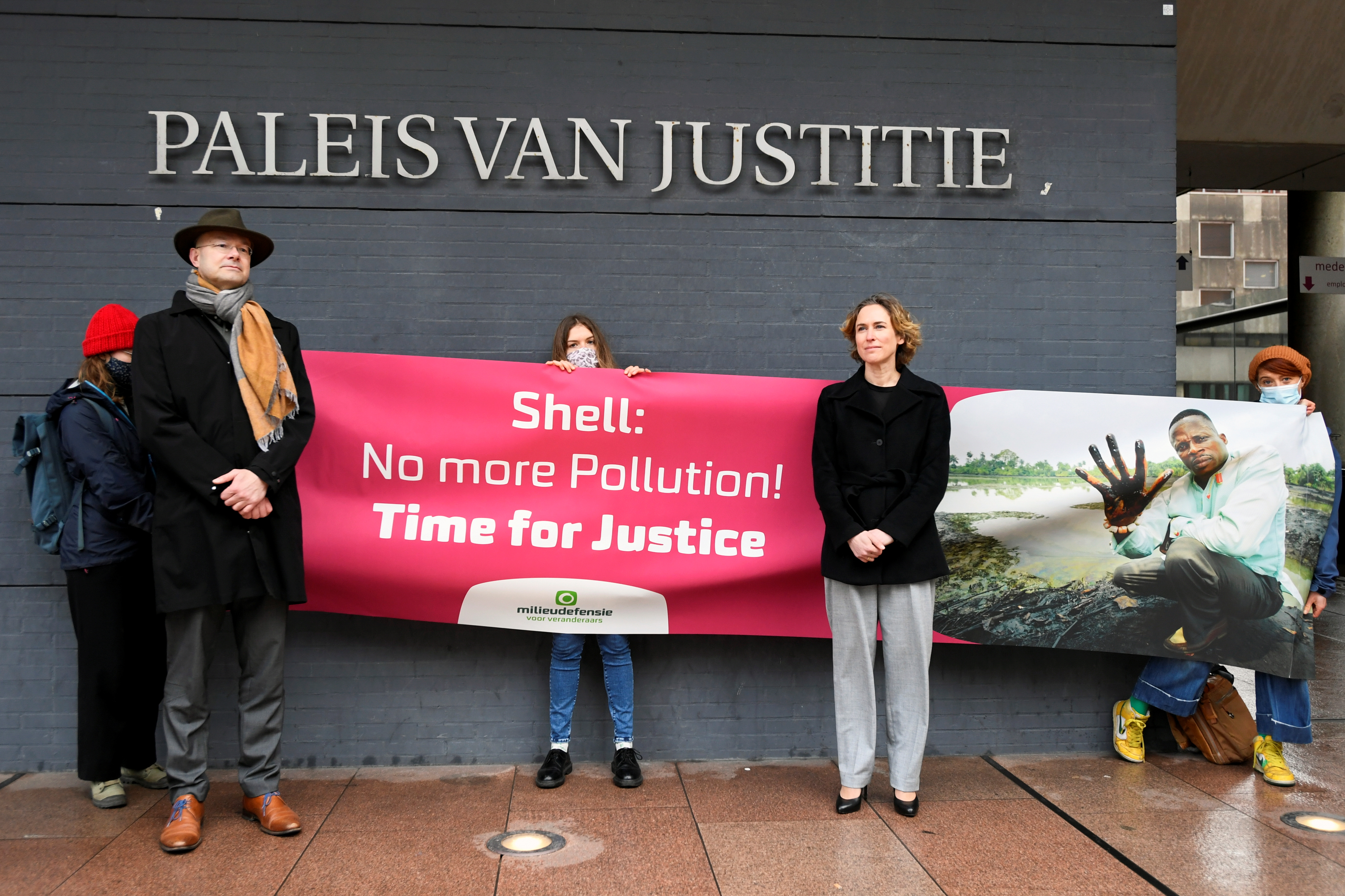 Donald Pols, Director of Milieudefensie, and Channa Samkalden, lawyer of Nigerian farmers and Milieudefensie, pose for a picture outside a Dutch appeals court ahead of the verdict in a case over oil major Shell's responsibility for oil pollution in the Niger Delta, in the Hague, Netherlands January 29, 2021. REUTERS/Piroschka Van De Wouw