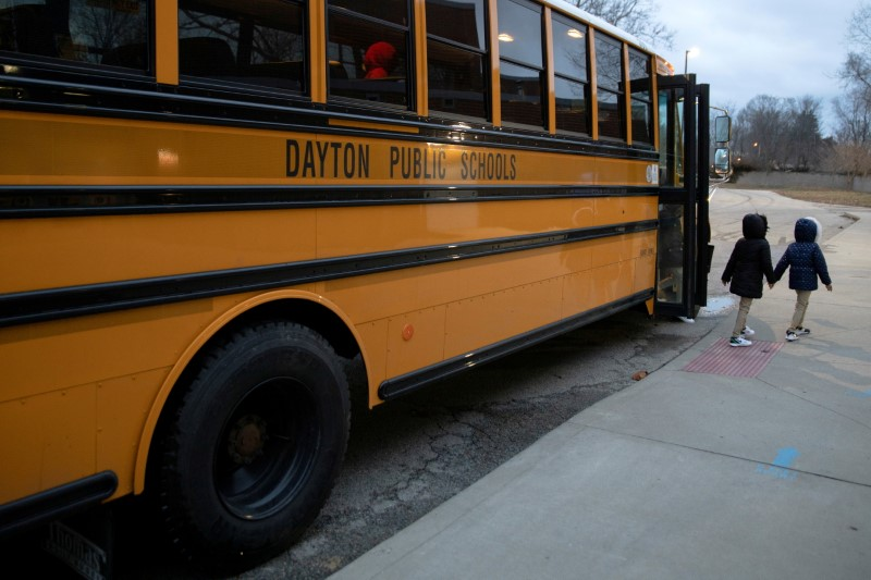 A bus drops students off as classes resume after teachers received the coronavirus disease (COVID-19) vaccination, at Westwood Elementary School in Dayton, Ohio, U.S., March 1, 2021. REUTERS/Megan Jelinger/File Photo