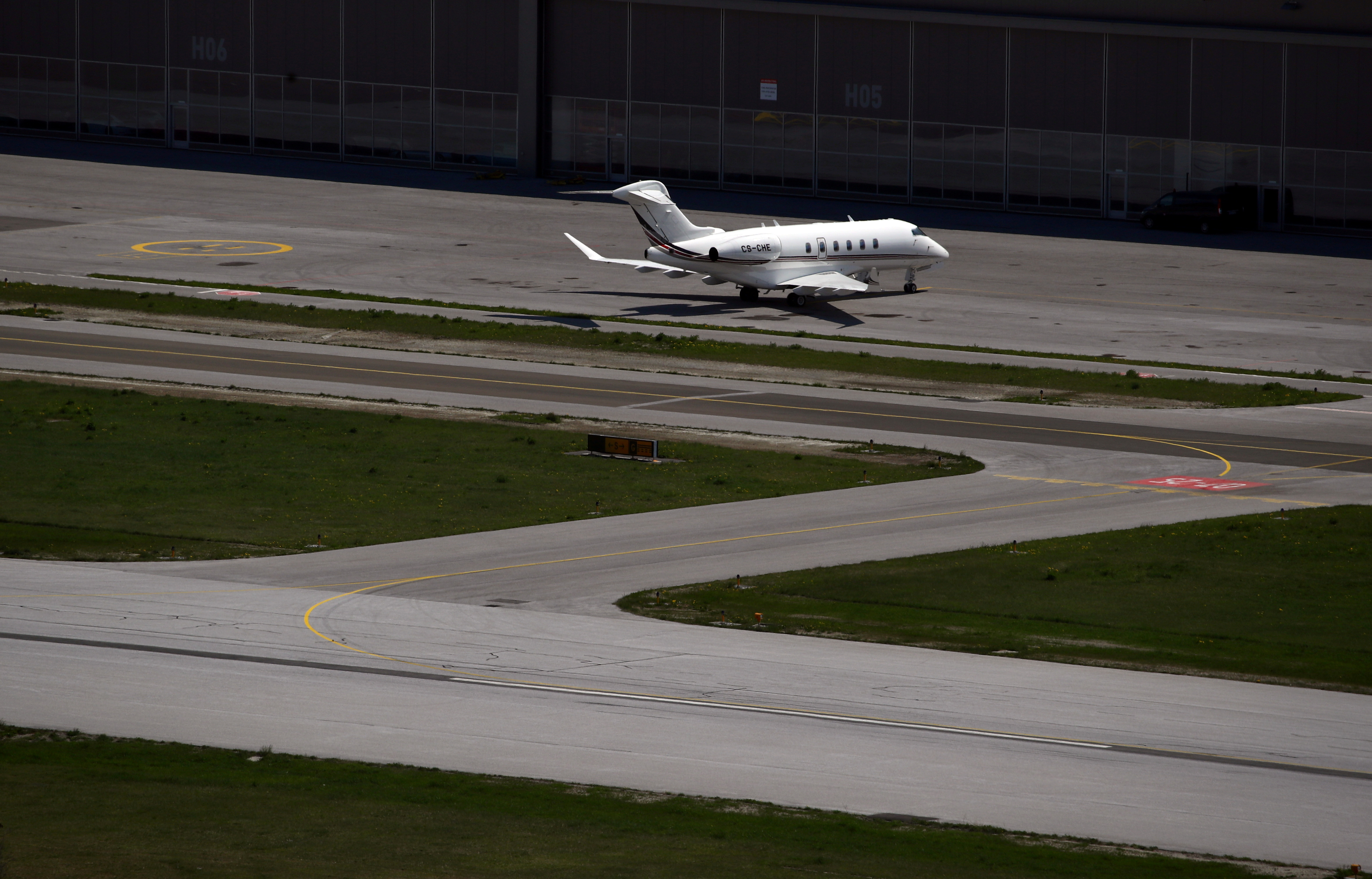 A Bombardier BD-100-1A10 Challenger 350 aircraft (Registration CS-CHE) of NetJets is pictured at Sion airport in Sion, Switzerland April 18, 2019. REUTERS/Denis Balibouse