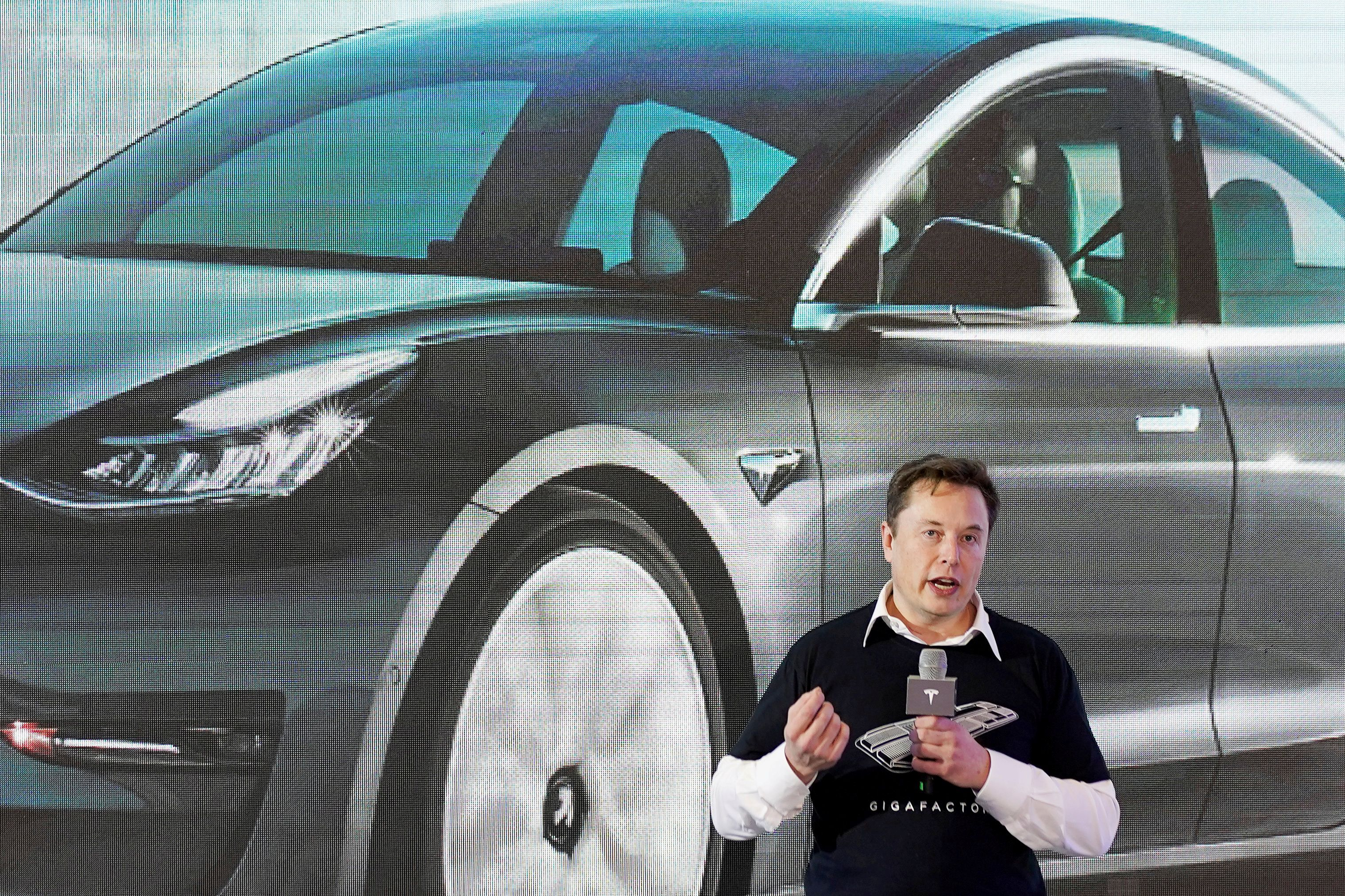 Tesla Inc CEO Elon Musk speaks onstage during a delivery event for Tesla China-made Model 3 cars at its factory in Shanghai, China January 7, 2020. REUTERS/Aly Song/File Photo