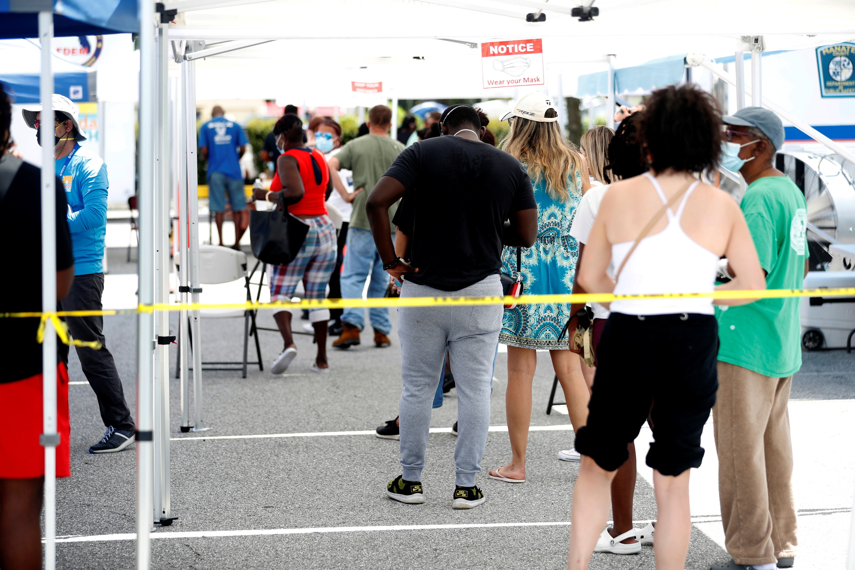 Patients wait in line to get a swab test at a COVID-19 mobile testing site hosted by the Manatee County Florida Department of Health in Palmetto, Florida, U.S., August 2, 2021.  REUTERS/Octavio Jones