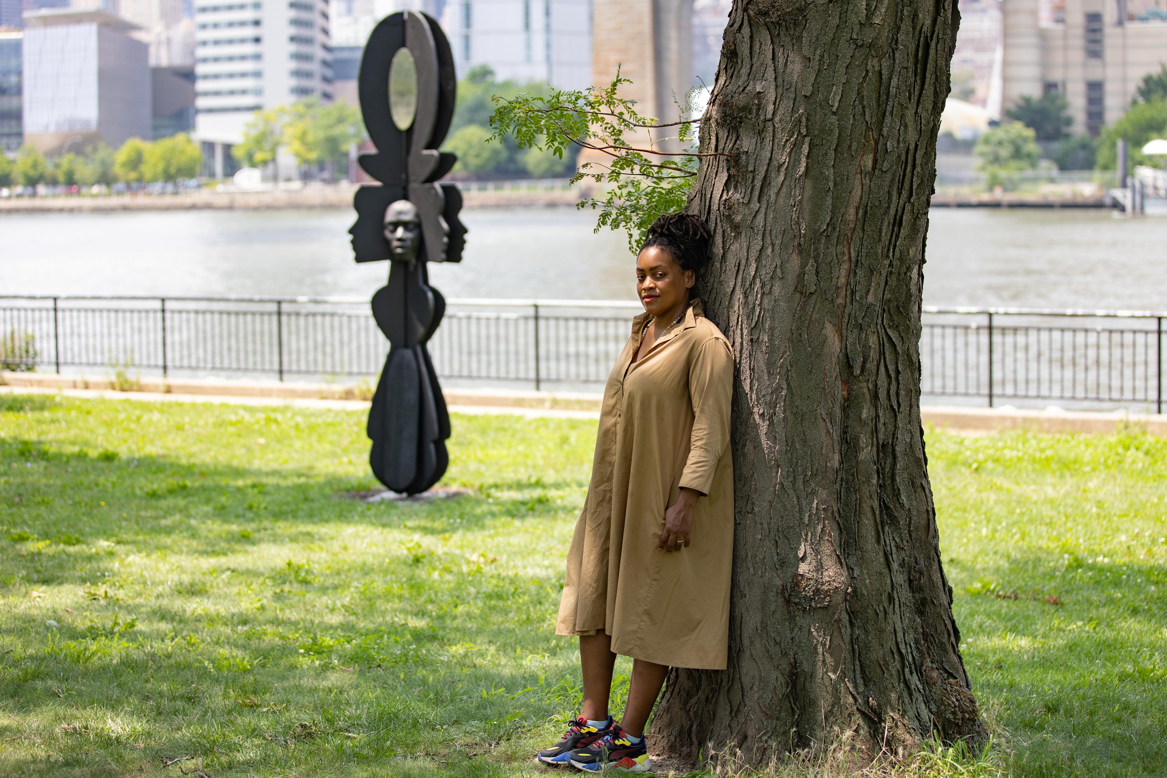 Artist Tanda Francis poses with her sculpture 'Be Heard' in Queensbridge Park, Queens borough of New York, U.S., July 16, 2021. REUTERS/Jeenah Moon