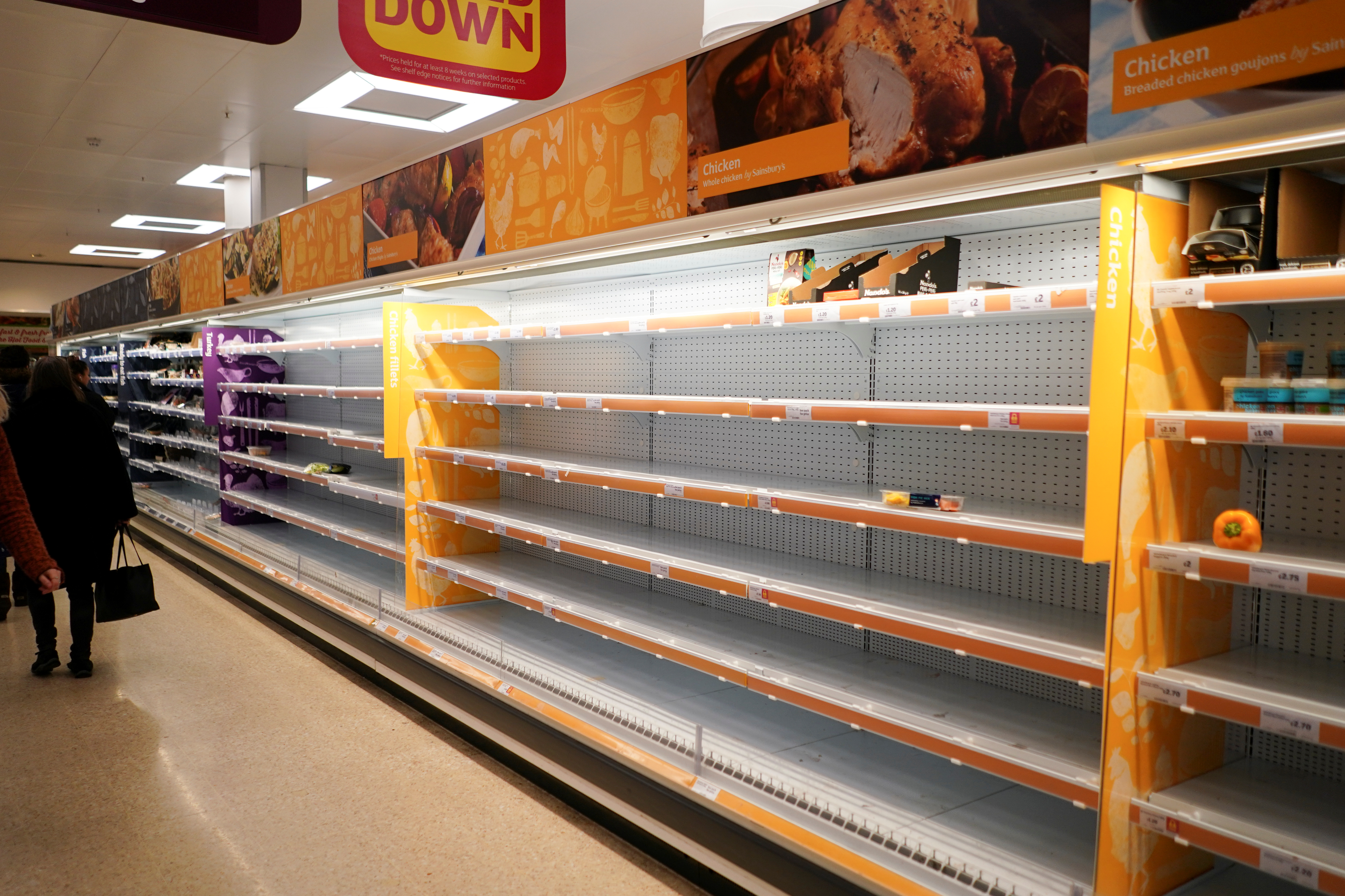 Shelves empty of fresh chicken in a supermarket, as the number of worldwide coronavirus cases continues to grow,  in London, Britain, March 15, 2020. REUTERS/Henry Nicholls