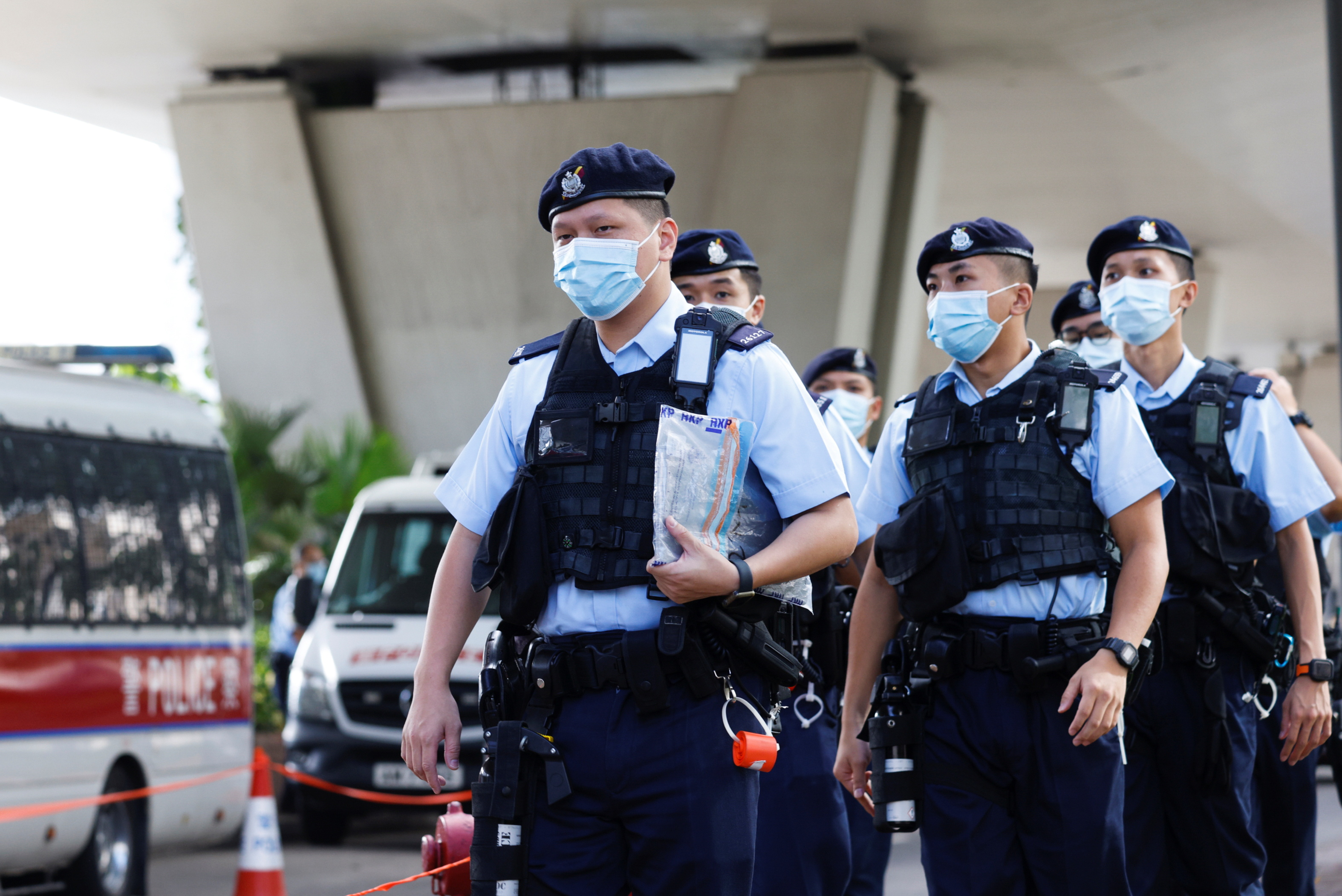 Police patrol outside the West Kowloon Magistrates' Courts building where a court hearing is taking place for Lam Man-chung, the former executive editor-in-chief of the now closed pro-democracy newspaper Apple Daily, in Hong Kong, China July 22, 2021. REUTERS/Tyrone Siu
