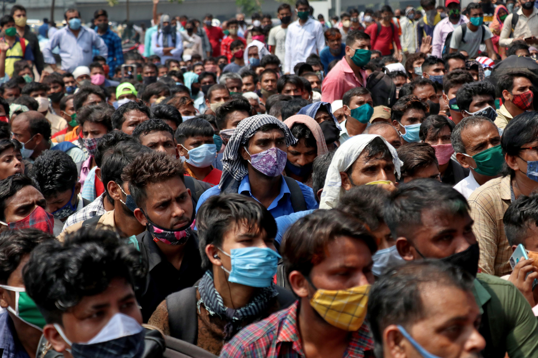 People wearing protective face masks wait to enter the Lokmanya Tilak Terminus railway station, amid the spread of the coronavirus disease (COVID-19) in Mumbai, India, April 12, 2021. REUTERS/Niharika Kulkarni/File photo