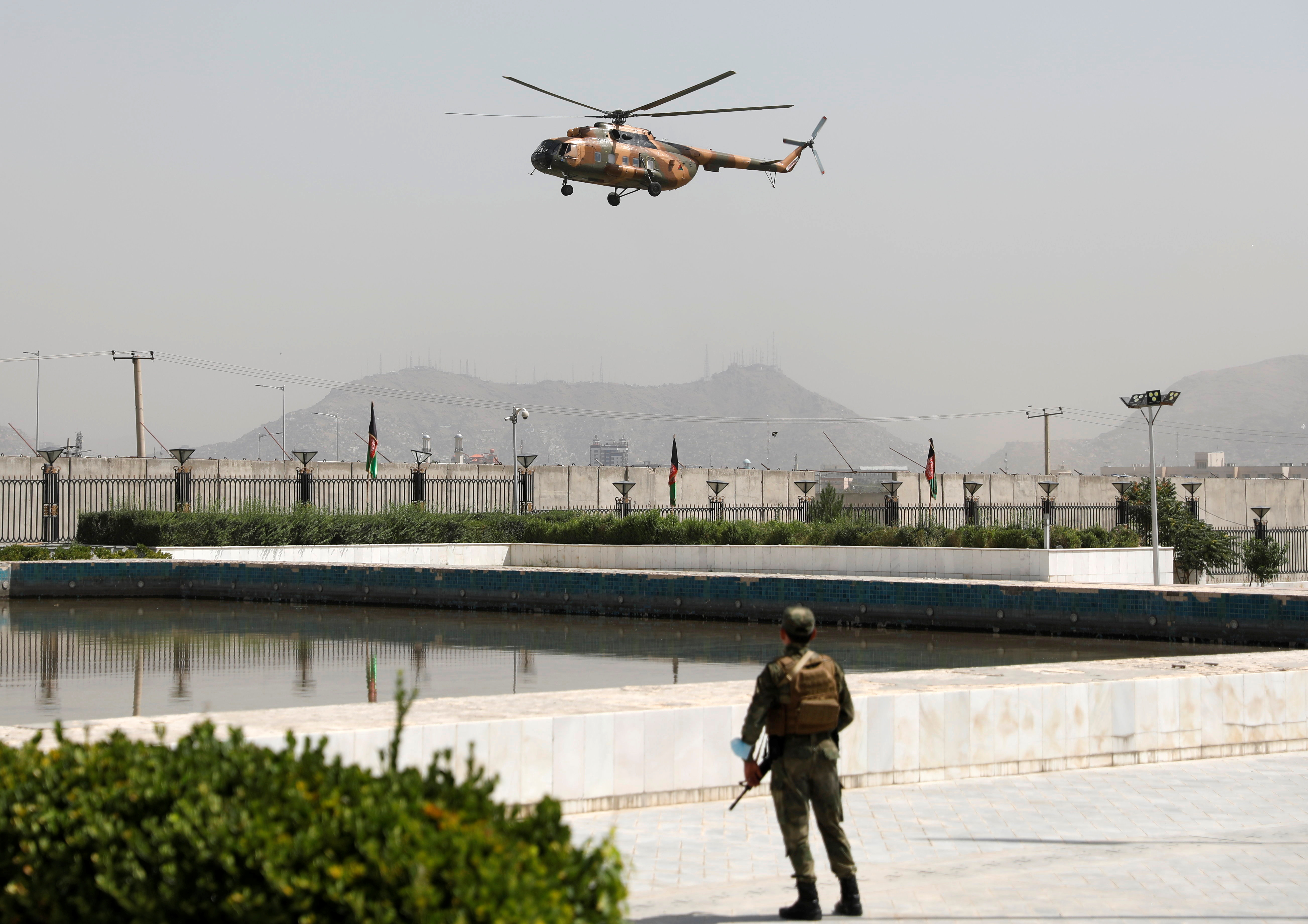 A military helicopter carrying Afghan President Ashraf Ghani prepares to land near the parliament in Kabul, Afghanistan August 2, 2021. REUTERS/Stringer