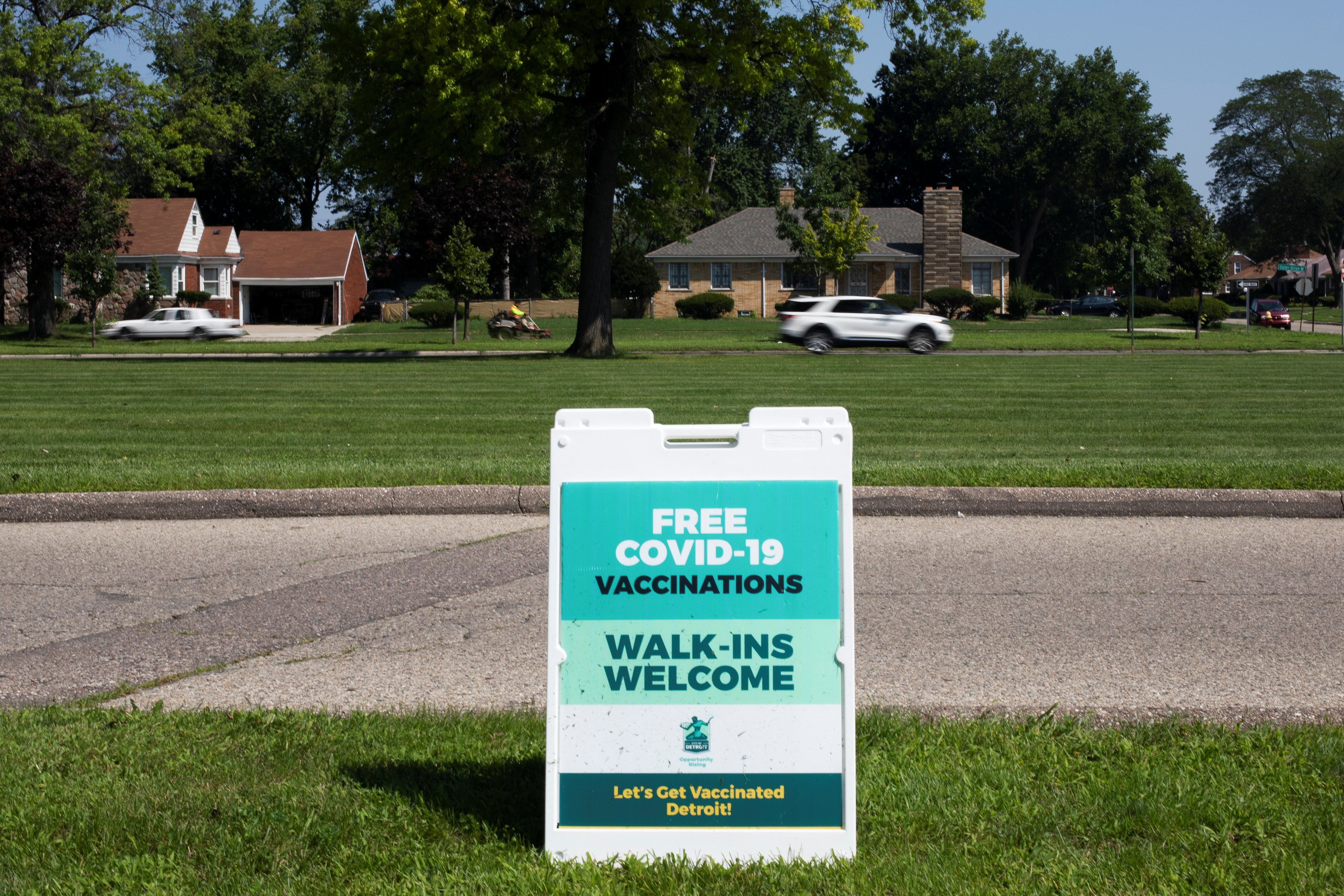 A sign is seen notifying the public that coronavirus disease (COVID-19) vaccines are available for walk-ins at a mobile pop-up vaccination clinic hosted by the Detroit Health Department with the Detroit Public Schools Community District at Renaissance High School in Detroit, Michigan, U.S., July 26, 2021. REUTERS/Emily Elconin