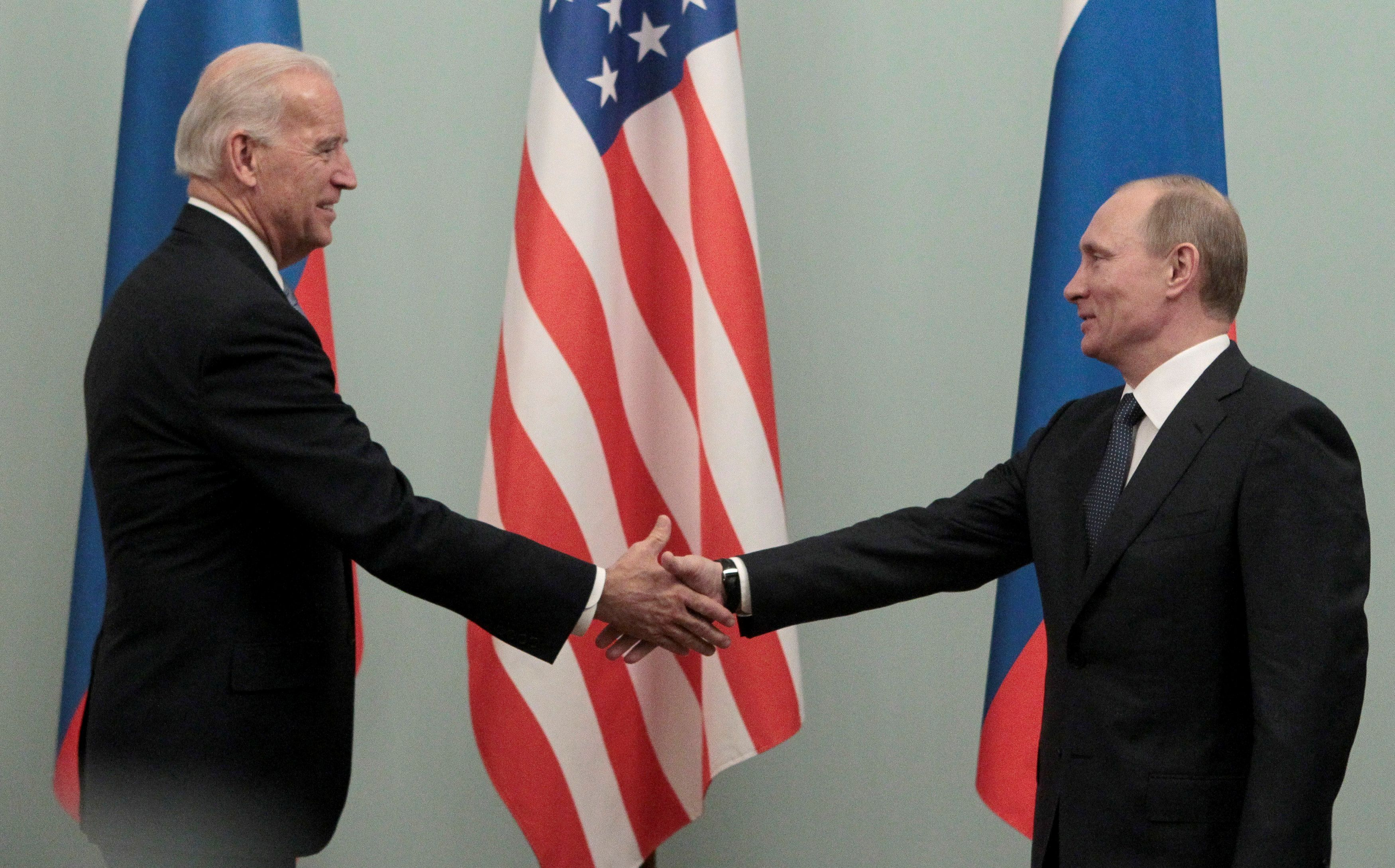Russian Prime Minister Vladimir Putin (R) shakes hands with U.S. Vice President Joe Biden during their meeting in Moscow March 10, 2011. REUTERS/Alexander Natruskin/File Photo