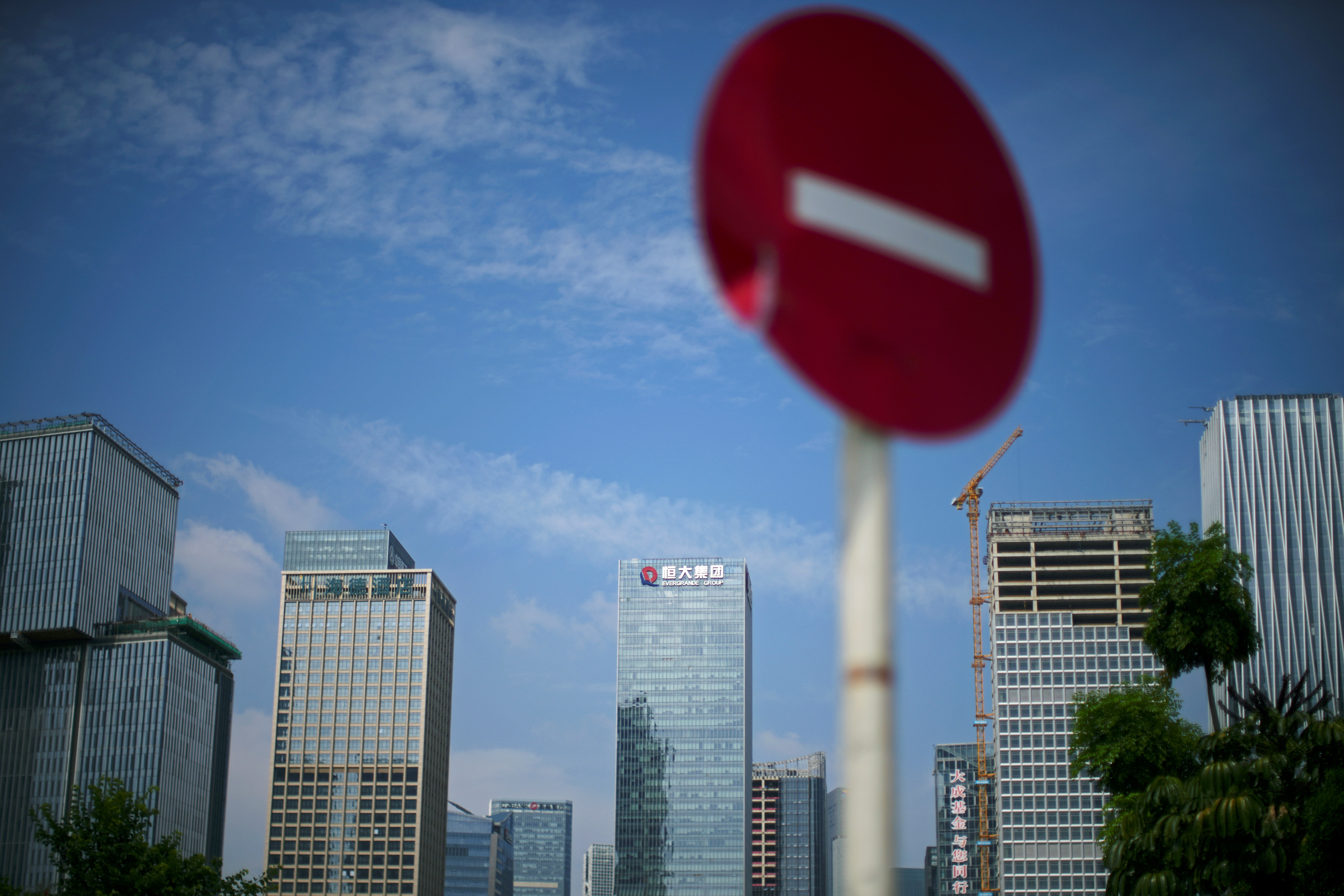 A No Entry traffic sign stands near the headquarters of China Evergrande Group in Shenzhen, Guangdong province, China September 26, 2021. REUTERS/Aly Song