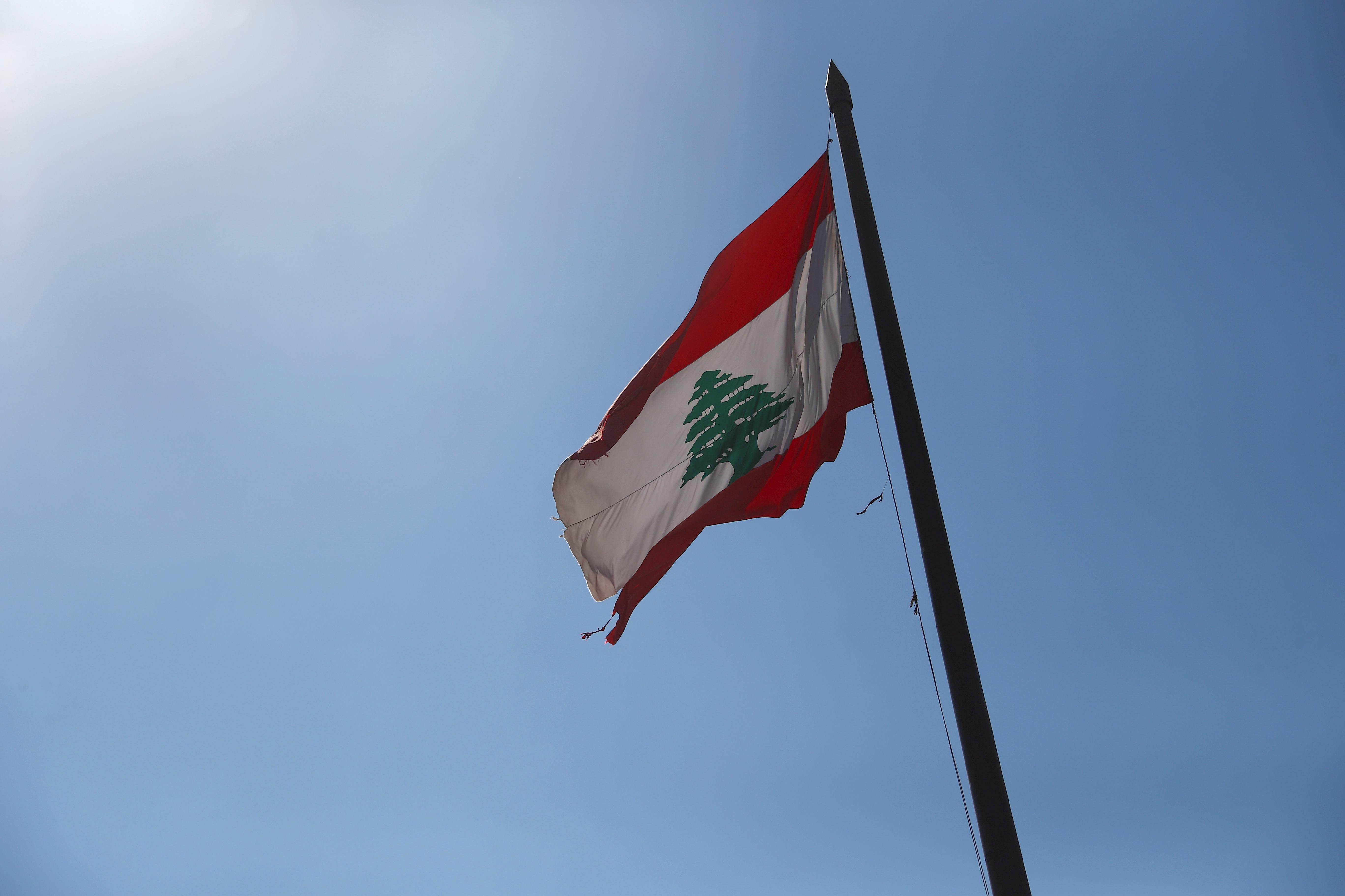 Lebanese national flag flutters in Beirut, Lebanon, August 18, 2020. REUTERS/Hannah McKay