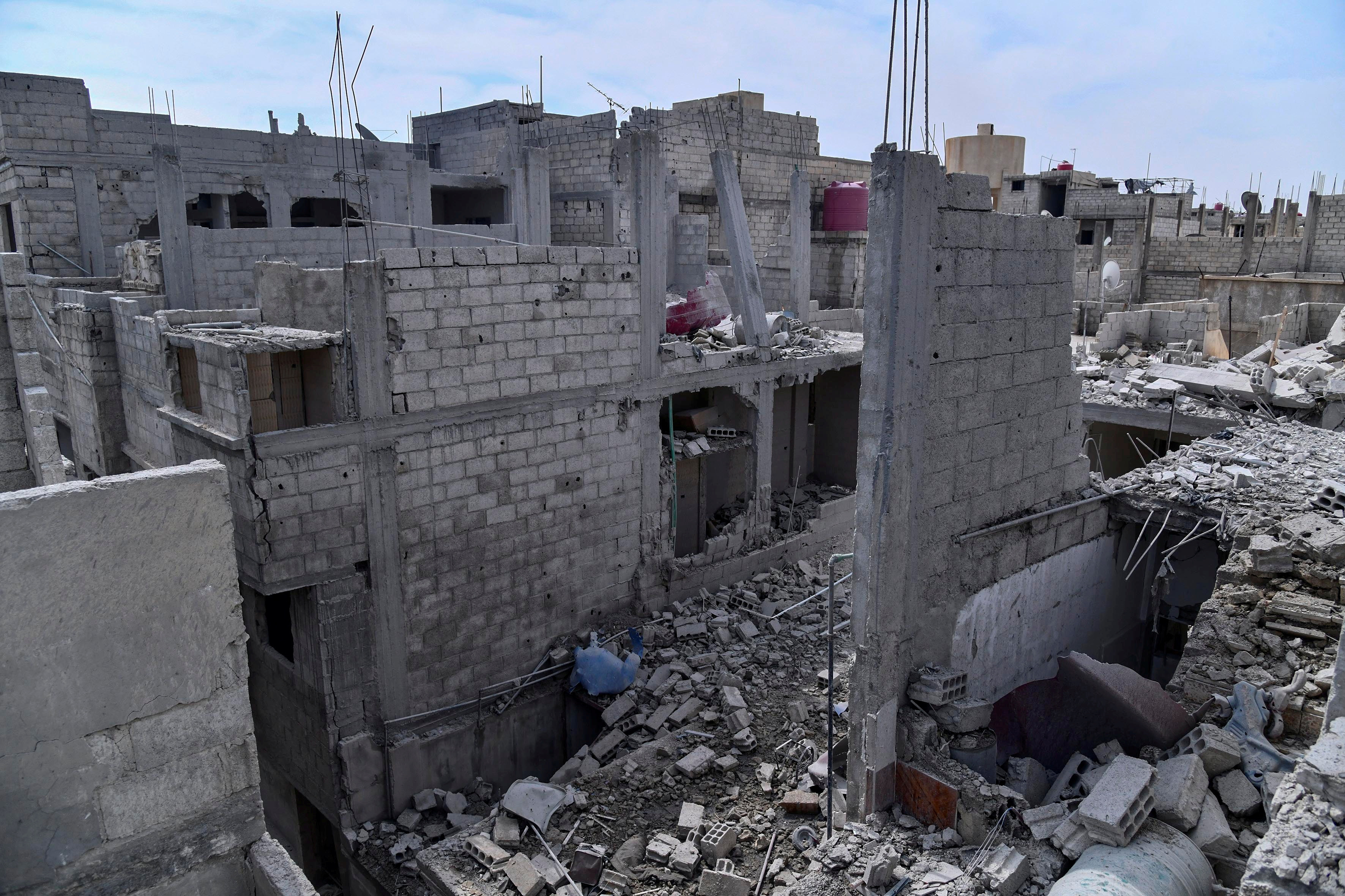 Damaged buildings are shown after what Syrian authorities said was an Israeli air strike in the western suburbs of Damascus, Syria in this handout released by state news agency SANA on April 27, 2020. SANA/Handout via REUTERS