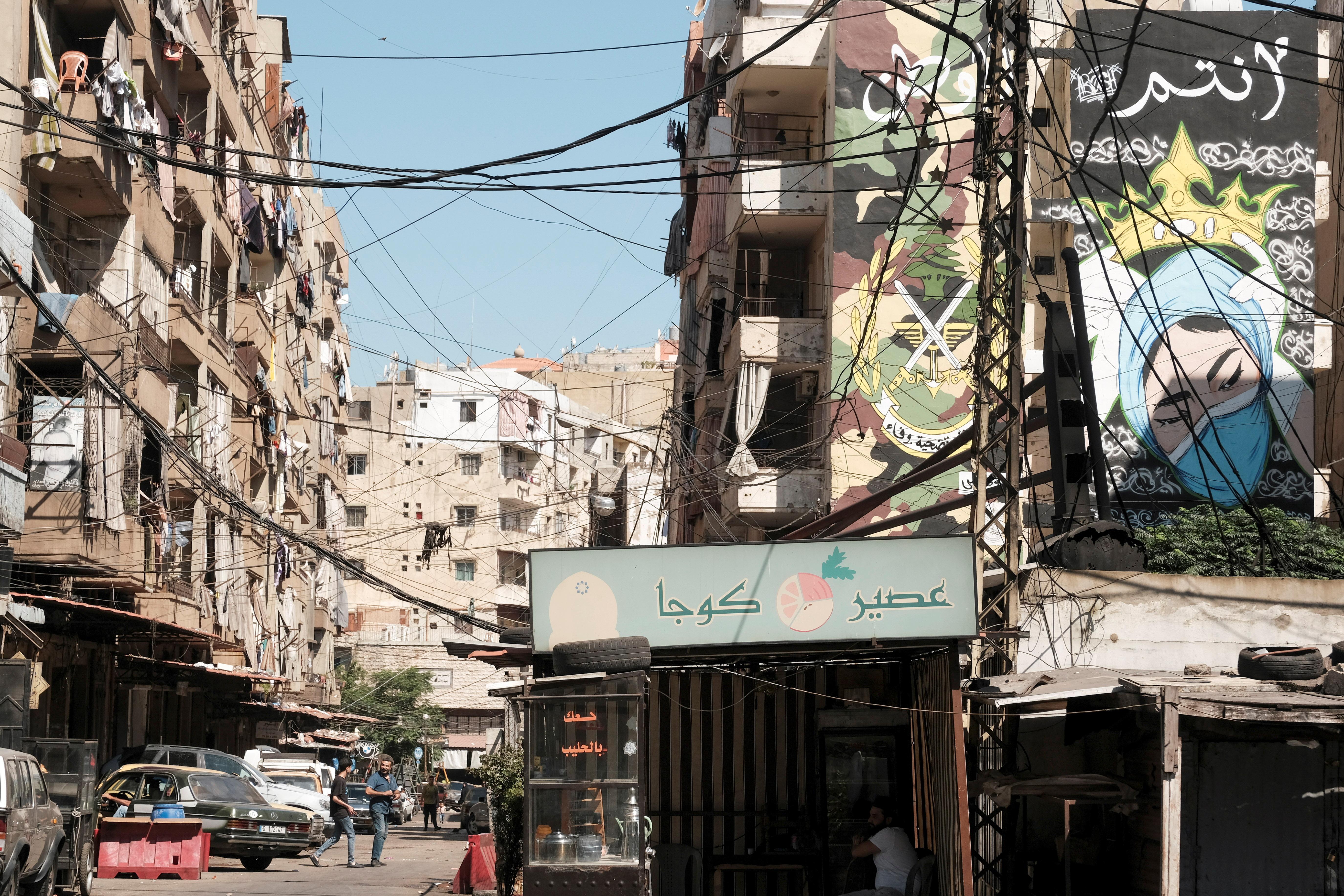 People walk along a street in Tripoli, Lebanon June 21, 2021.   REUTERS/Emilie Madi