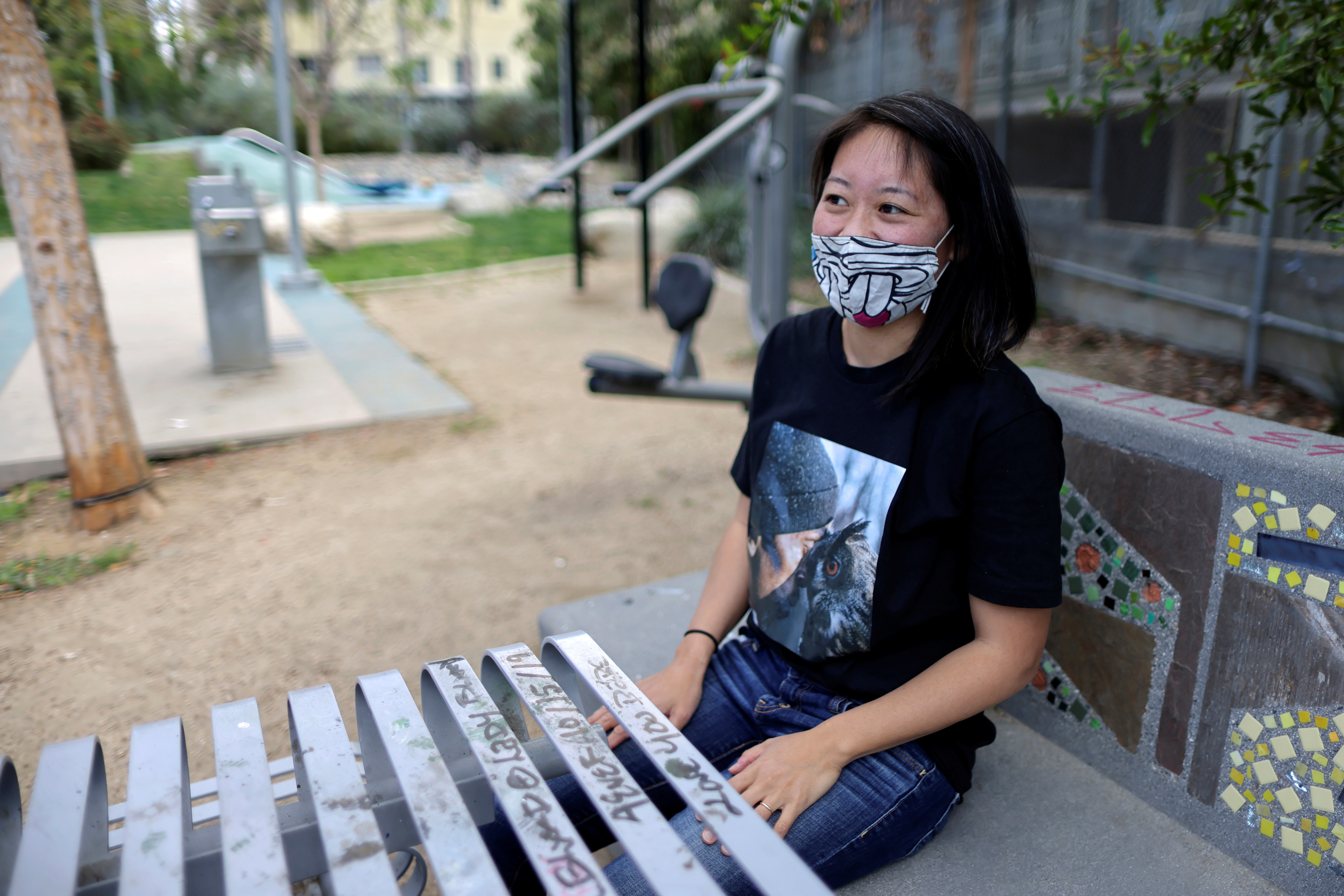 Tracy Park sits in the park in which she was shouted at, as the coronavirus disease (COVID-19) pandemic continues, in Hollywood, Los Angeles, California, U.S., April 27, 2021. REUTERS/Lucy Nicholson