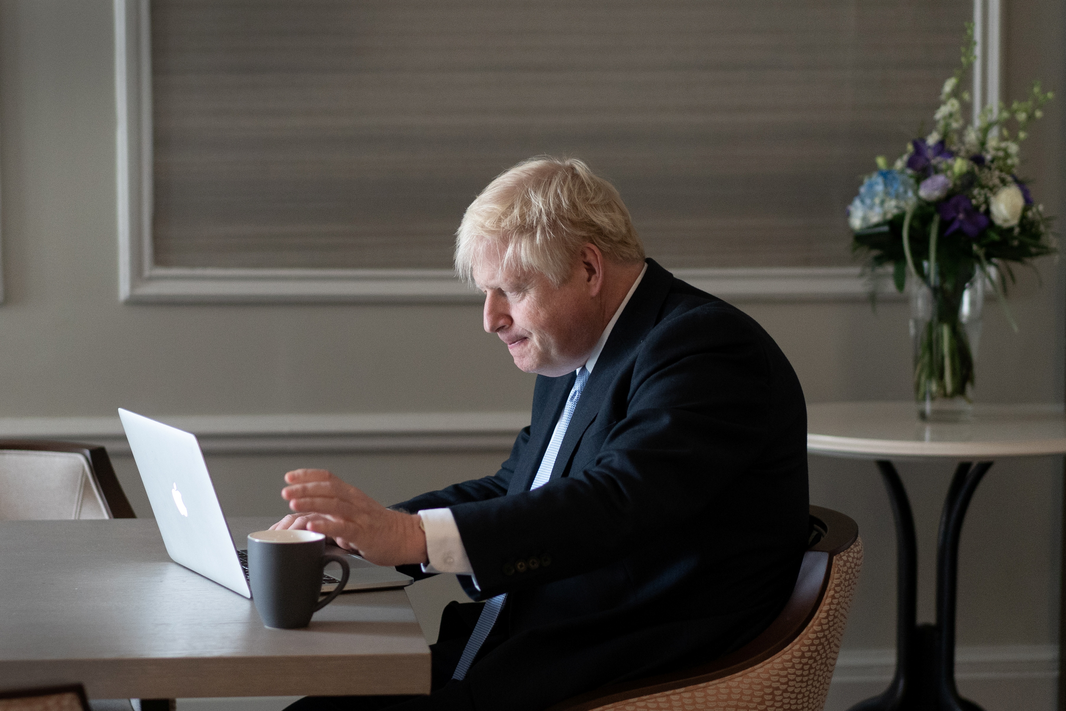 Britain's Prime Minister Boris Johnson prepares his keynote speech in his hotel room before addressing the Conservative Party Conference the following day, in Manchester, Britain October 5, 2021. Stefan Rousseau/Pool via REUTERS