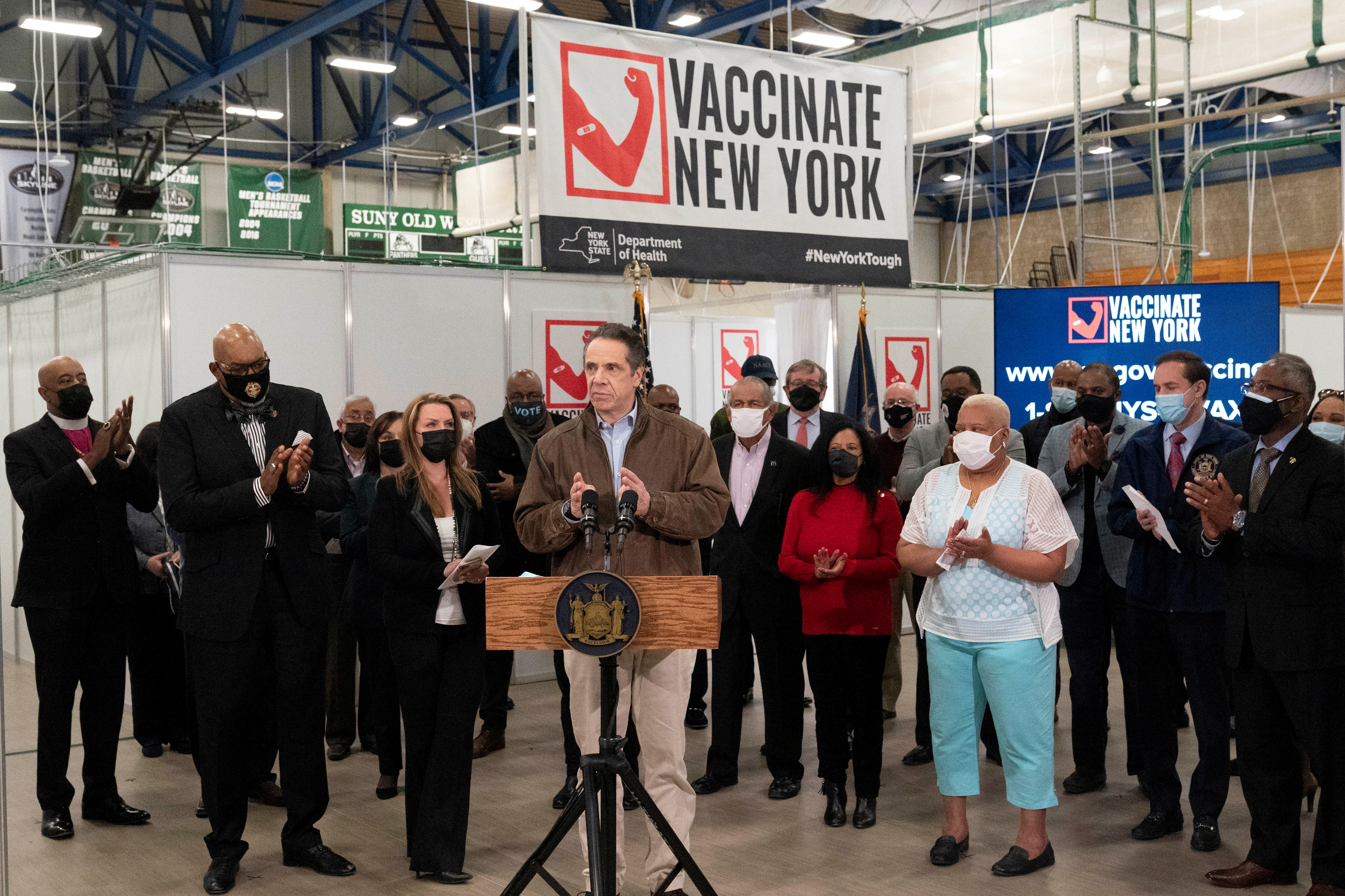 Gov. Andrew Cuomo speaks during a visit to a coronavirus disease (COVID-19) vaccination site, at the State University of New York in Old Westbury, New York, U.S,  March 15, 2021. Mark Lennihan/Pool via REUTERS/File Photo