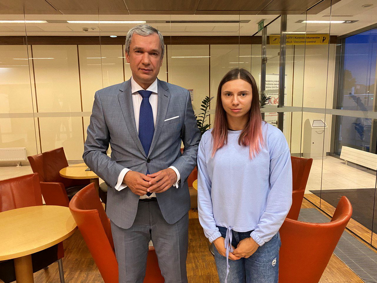 Belarusian opposition politician Pavel Latushka poses with Belarusian sprinter Krystsina Tsimanouskaya, who left the Olympic Games in Tokyo and seeks for asylum in Poland, on her arrival to Warsaw, Poland August 4, 2021. TWITTER/@PavelLatushka via Reuters