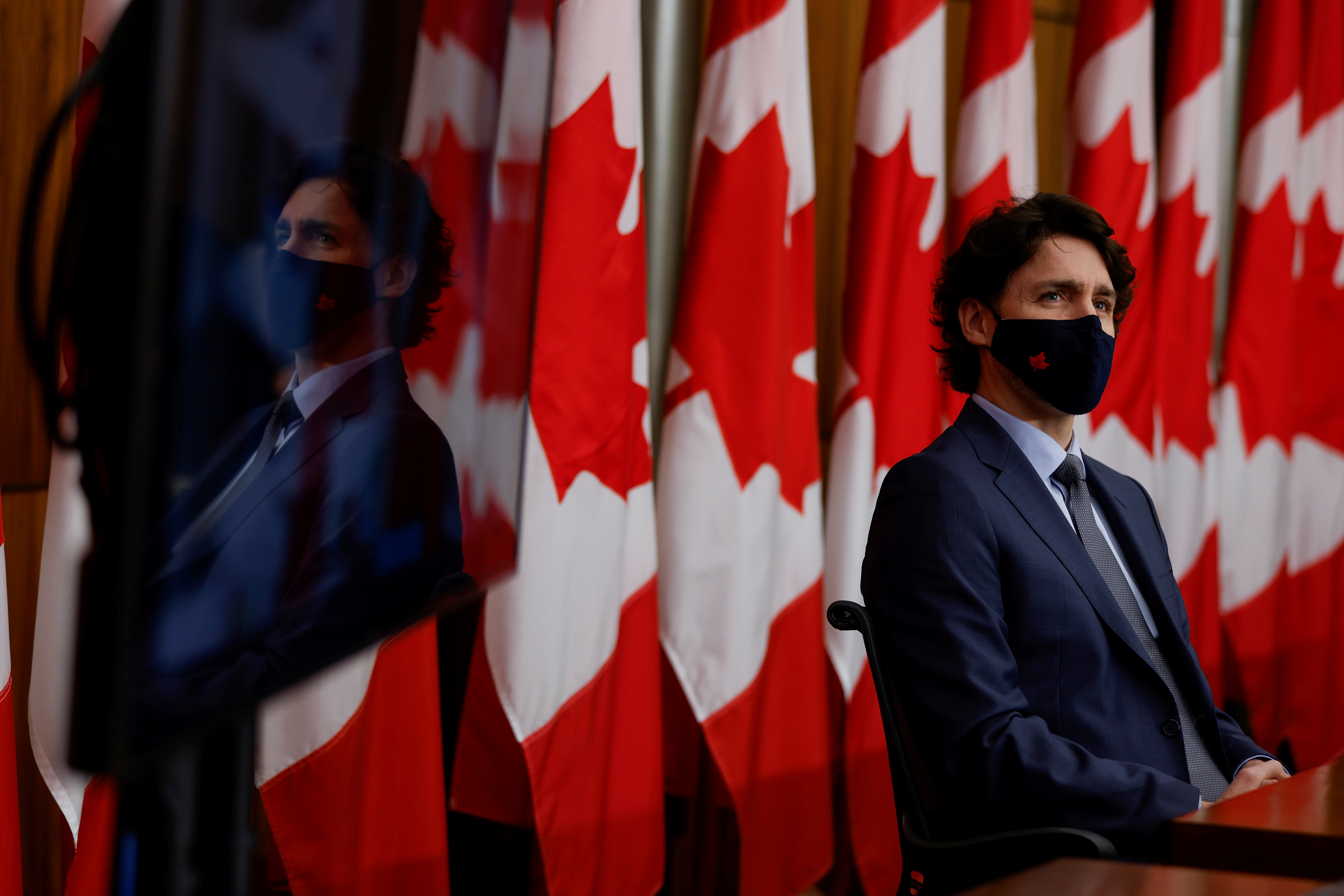 Canada's prime minister, Justin Trudeau, wearing a protective face mask, attends a news conference, as efforts continue to help slow the spread of the coronavirus disease (COVID-19), in Ottawa, Ontario, Canada March 5, 2021. REUTERS/Blair Gable/File Photo