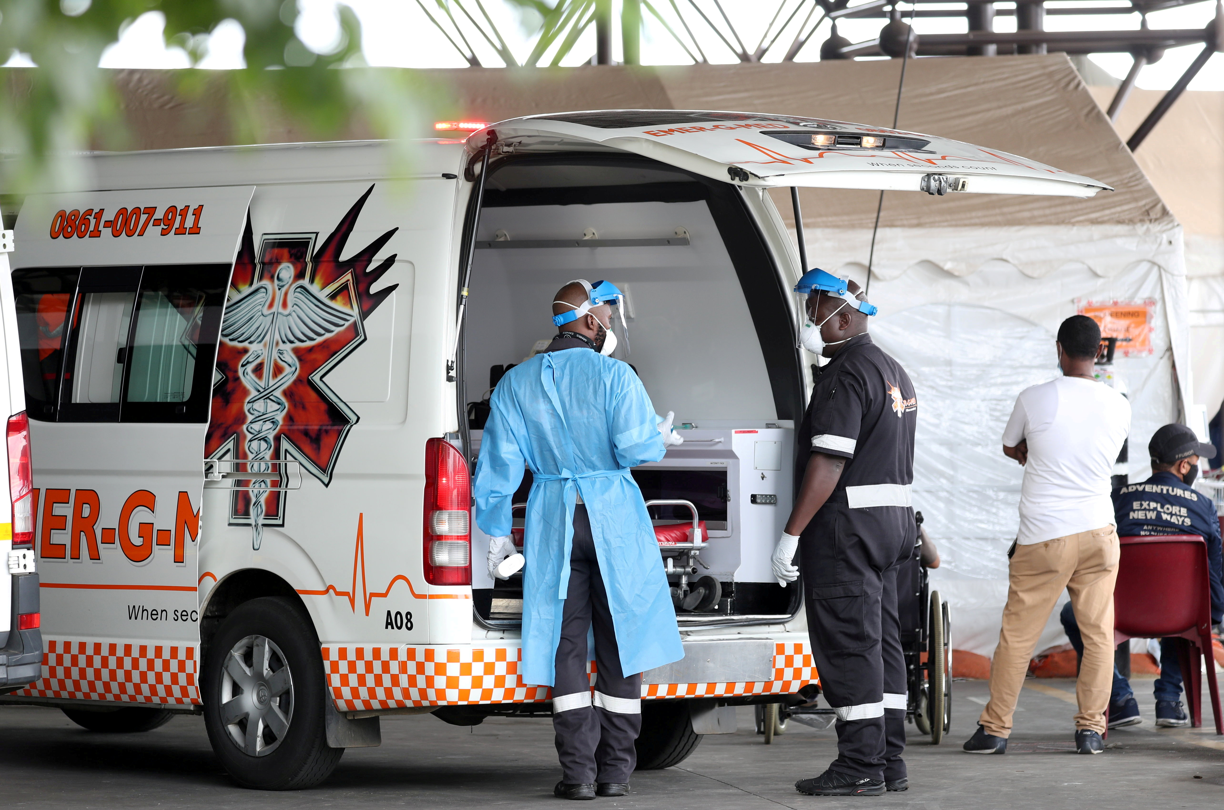Health workers chat near an ambulance  at the parking lot of the Steve Biko Academic Hospital, amid a nationwide coronavirus disease (COVID-19) lockdown, in Pretoria, South Africa, January 11, 2021. REUTERS/Siphiwe Sibeko/File Photo