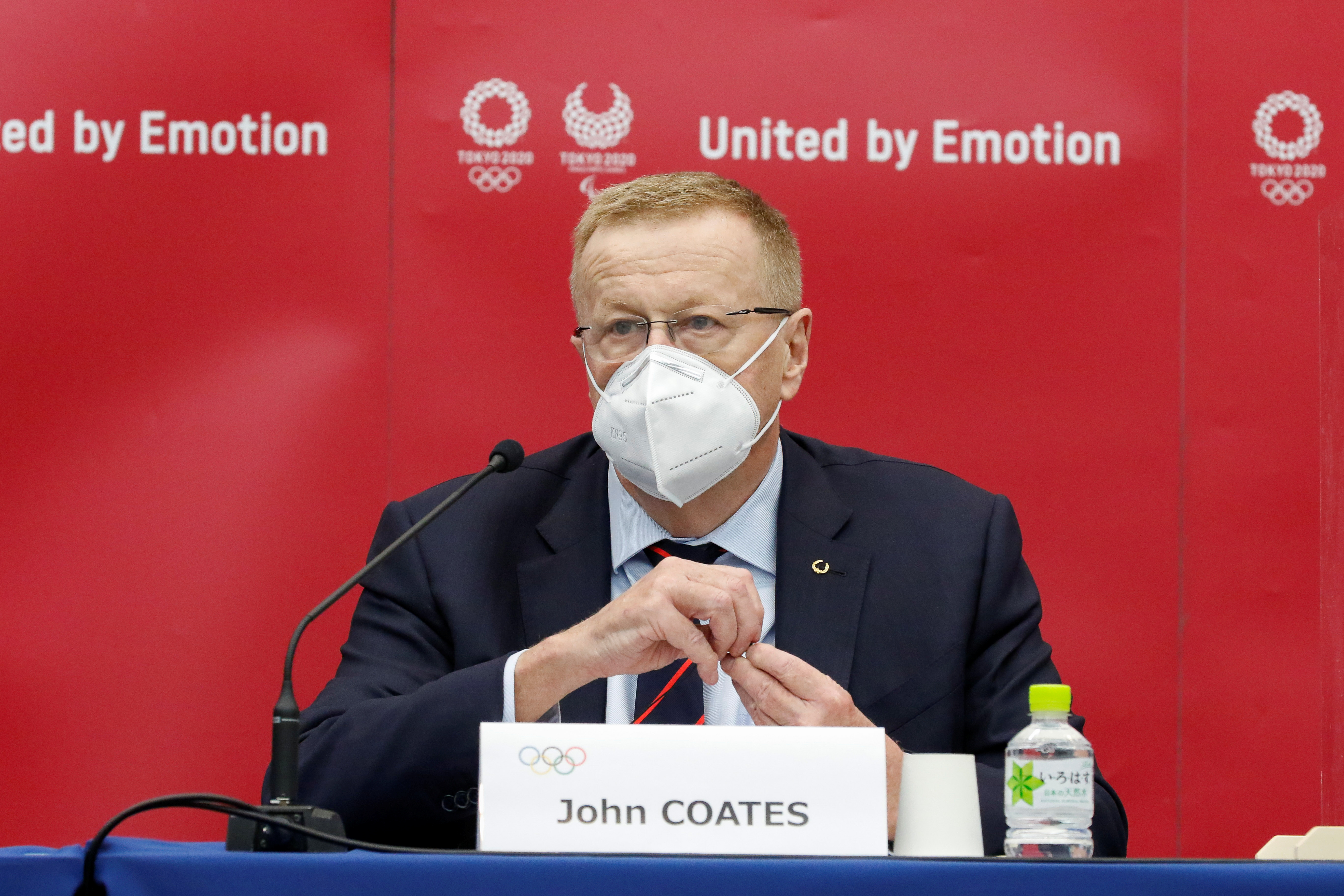 John Coates, Chairman of the Coordination Commission for the Games of the XXXII Olympiad Tokyo 2020, wears a face mask as he speaks during a joint press conference with the organizers of Tokyo 2020 at Harumi Island Triton Square Tower Y in Tokyo, Japan November 18, 2020. Rodrigo Reyes Marin/Pool via REUTERS