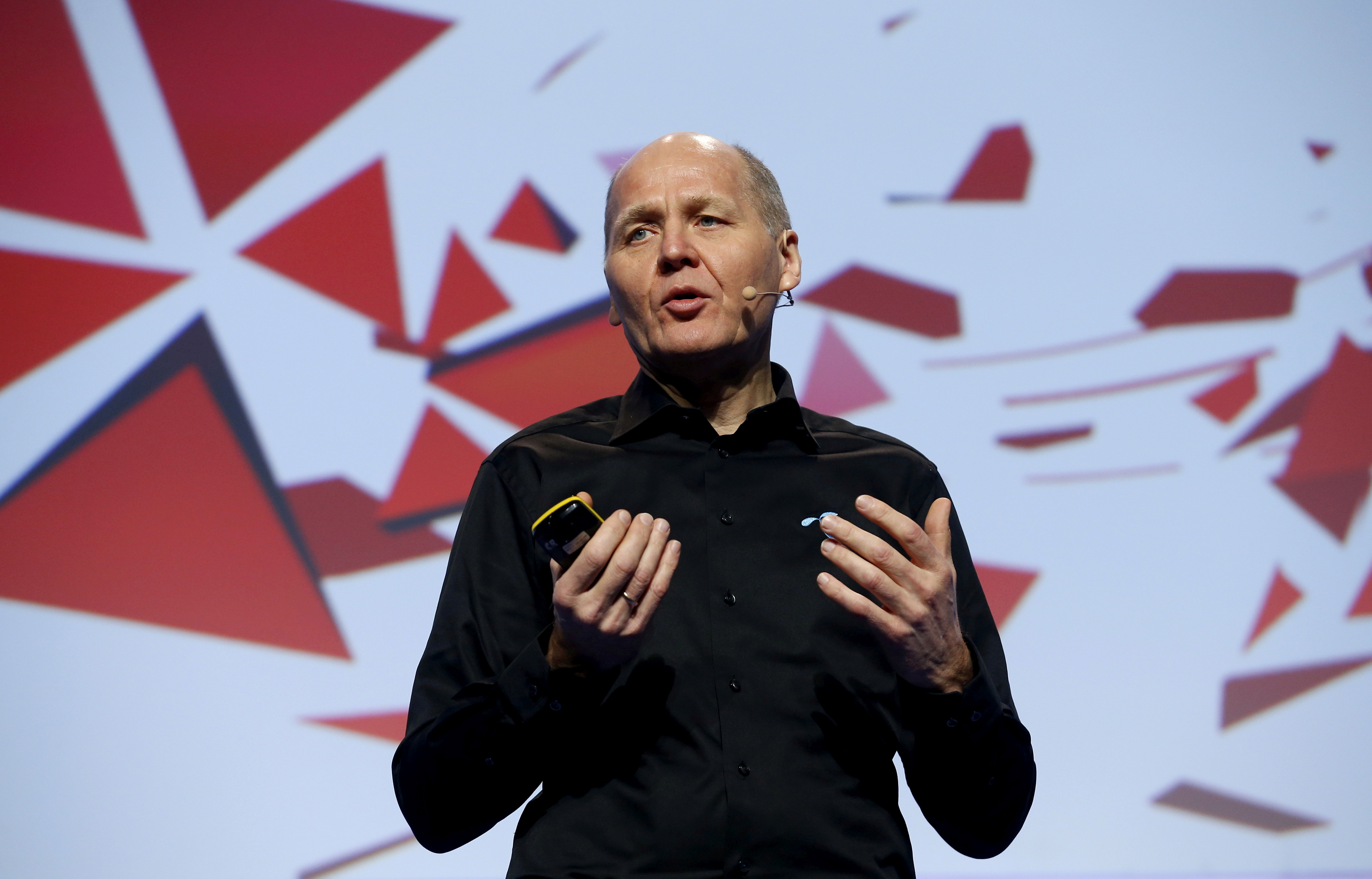 Sigve Brekke, President and CEO of Telenor, delivers a keynote speech during the Mobile World Congress in Barcelona, Spain February 23, 2016. REUTERS/Albert Gea/File Photo