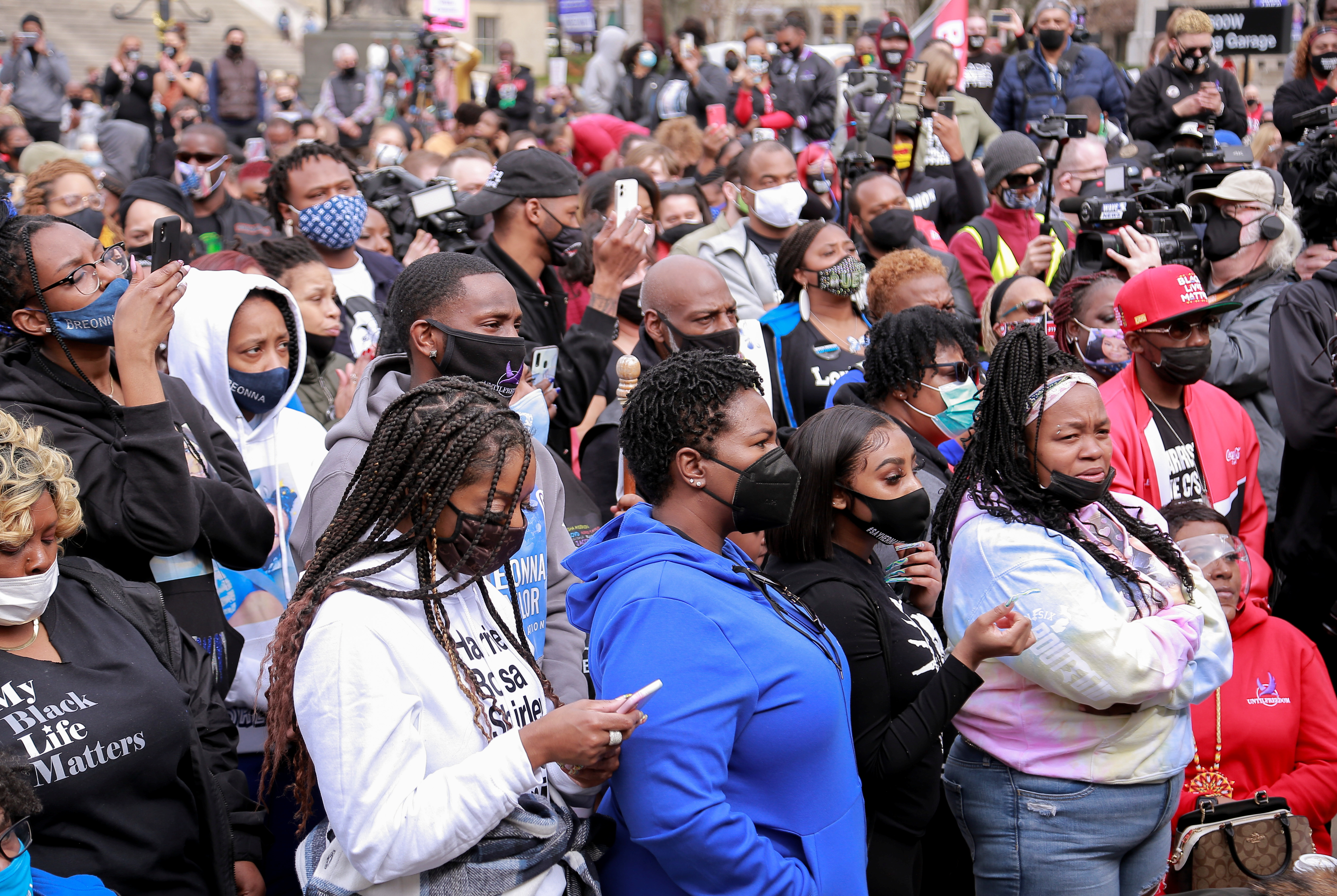 People attend a rally to mark one year since police officers shot and killed Breonna Taylor when they entered her home, in Louisville, Kentucky, U.S., March 13, 2021. REUTERS/Amira Karaoud
