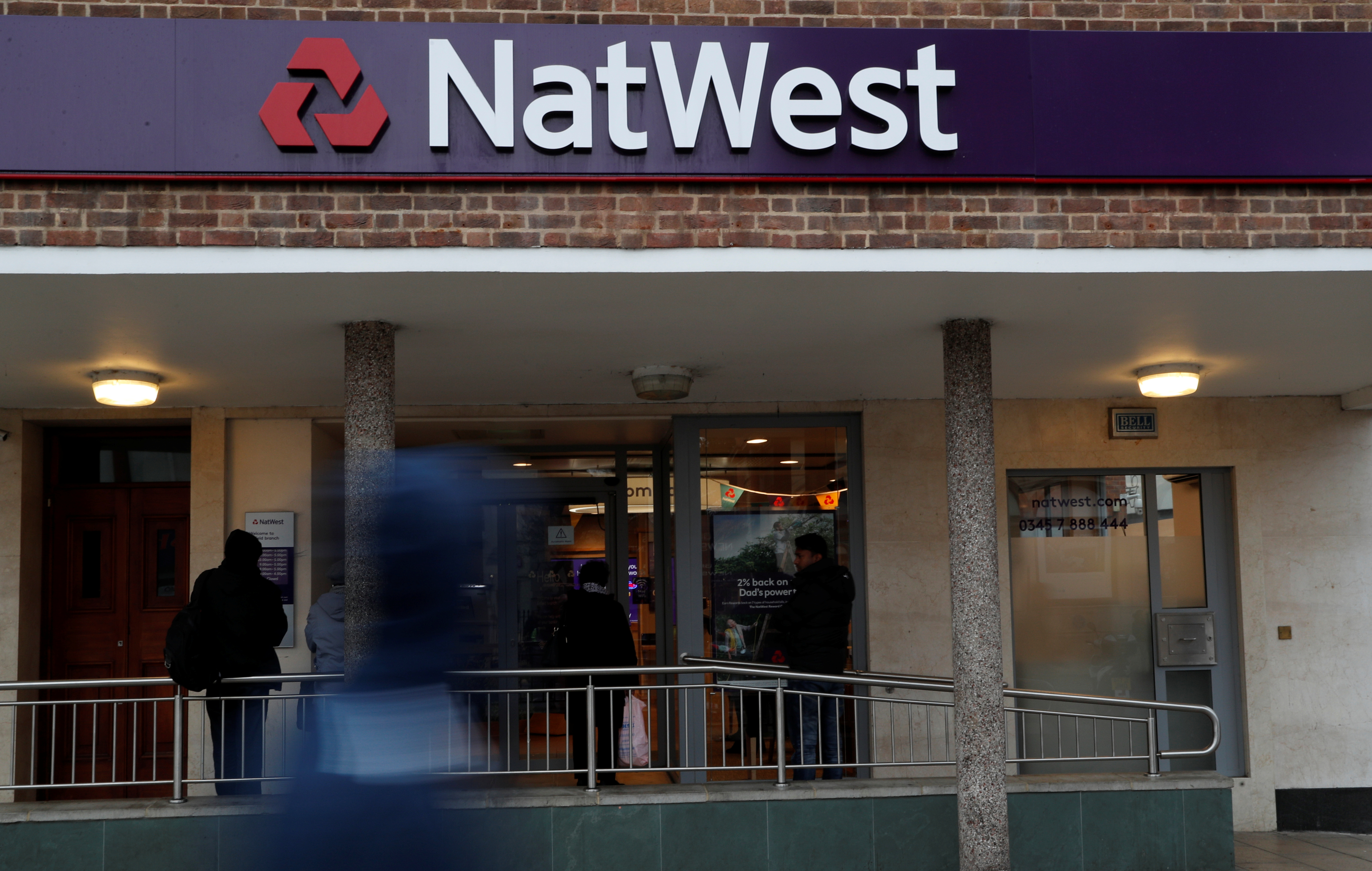 The logo of NatWest Bank, part of the Royal Bank of Scotland group is seen outside a branch in Enfield, London Britain November 15, 2017. REUTERS/John Sibley
