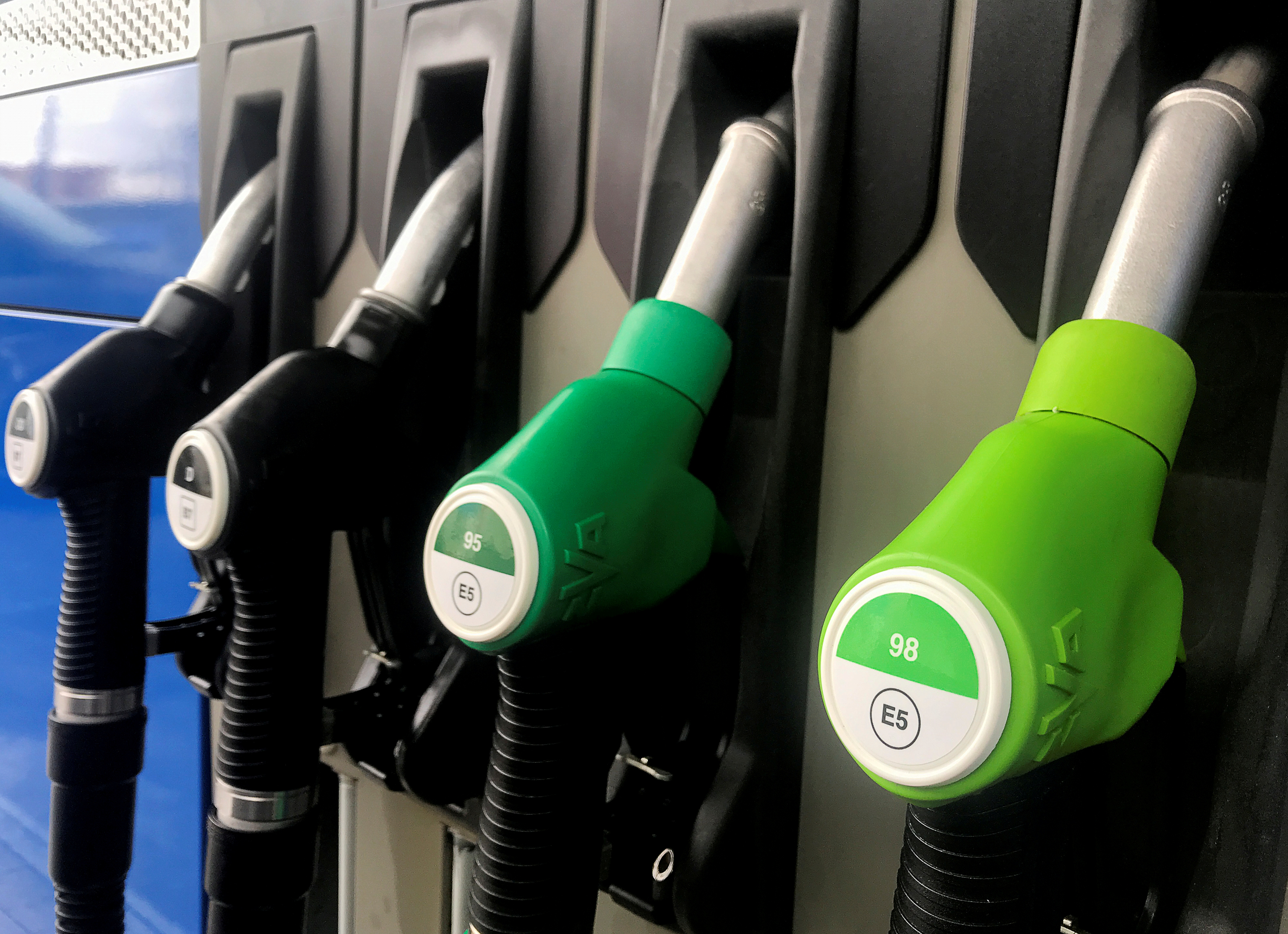 Fuel nozzles with new European labels to standardise pumps in the EU zone are seen at a petrol station in Madrid, Spain, October 11, 2018. REUTERS/Sergio Perez/File Photo