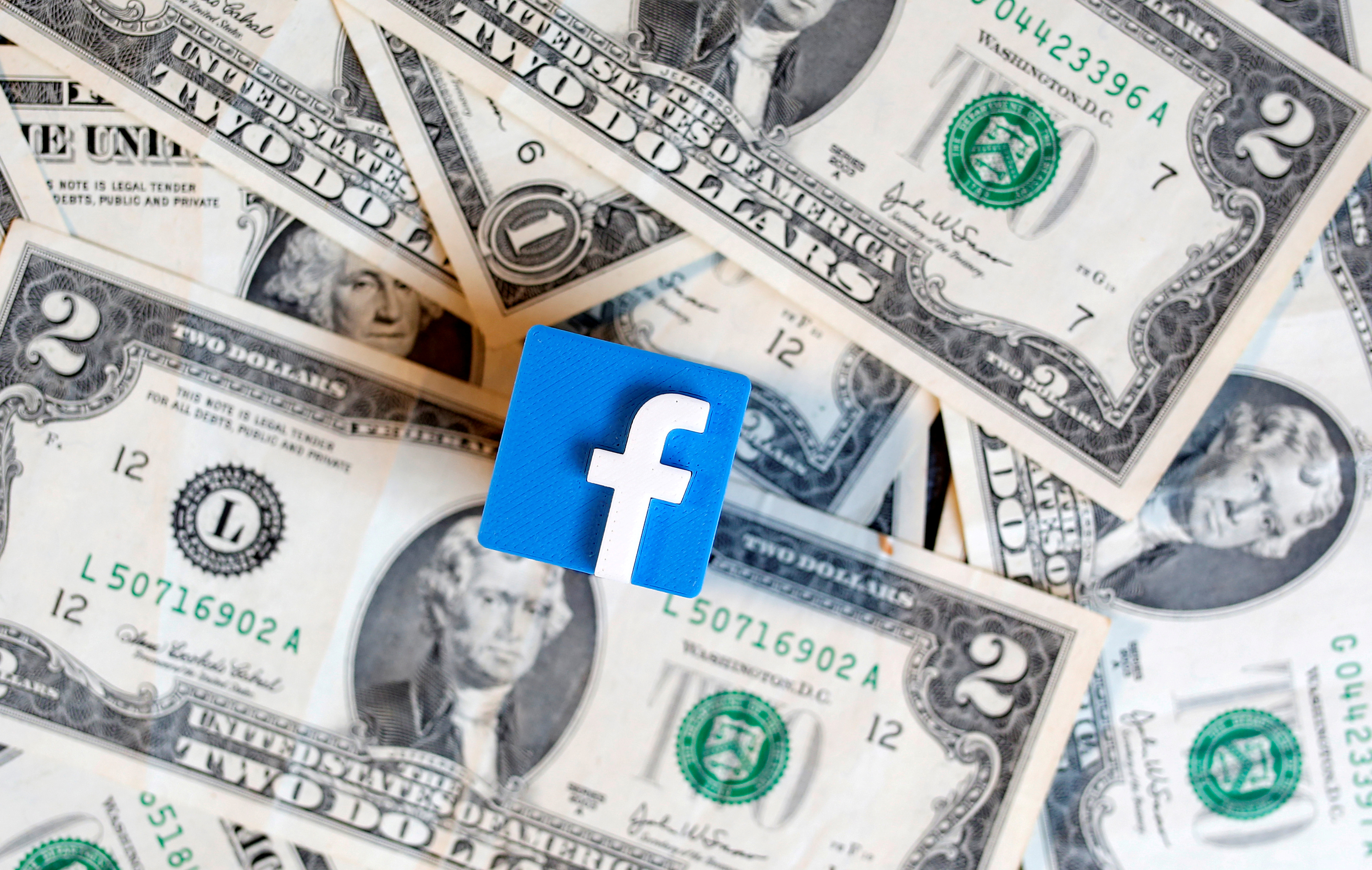 A 3-D printed Facebook logo is seen on U.S. dollar banknotes in this illustration picture, June 18, 2019. REUTERS/Dado Ruvic/Illustration/File Photo/File Photo