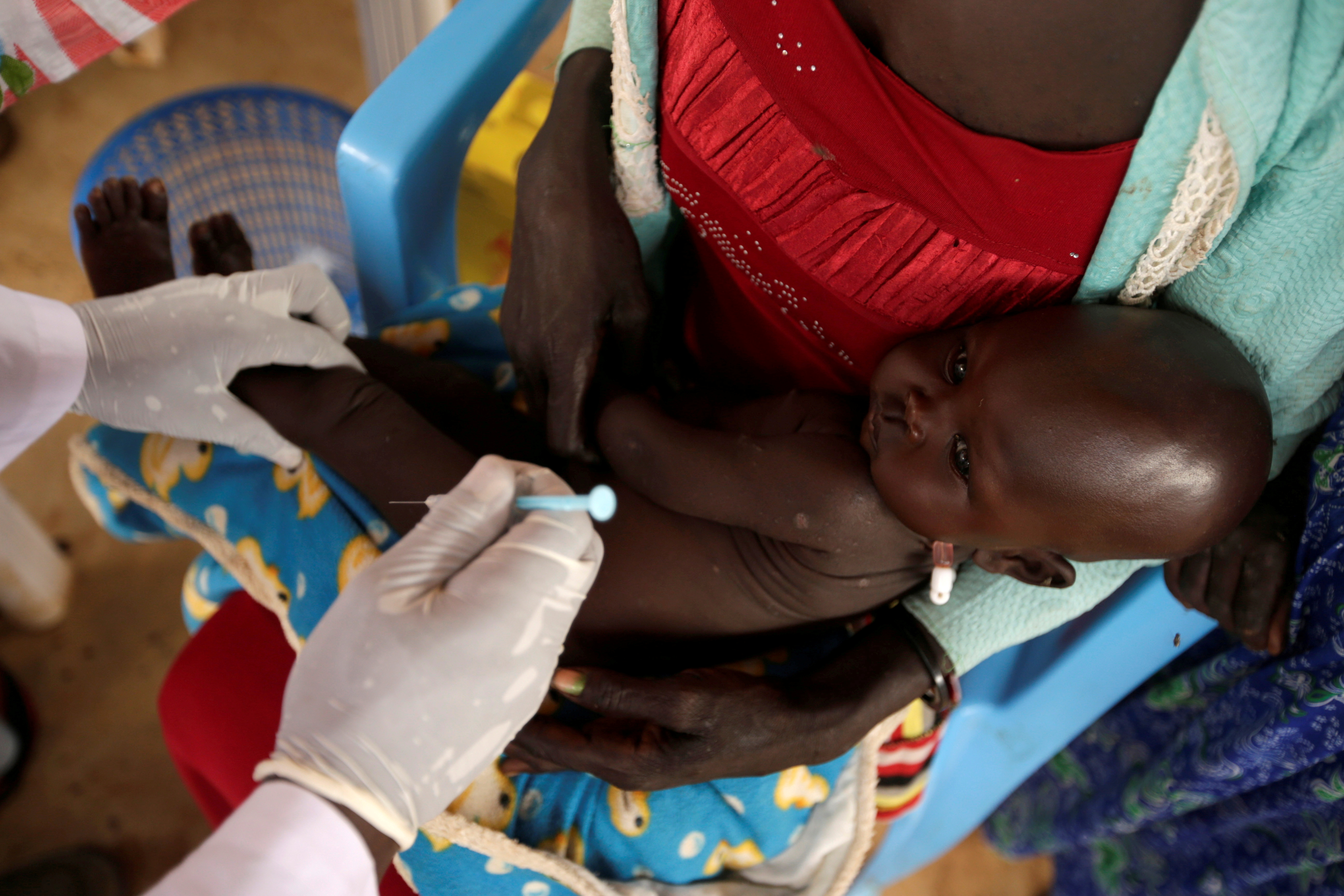 A South Sudanese refugee child is vaccinated at the Nguenyyiel refugee in the Gambella Region, Ethiopia, October 24, 2017. REUTERS/Tiksa Negeri/File Photo