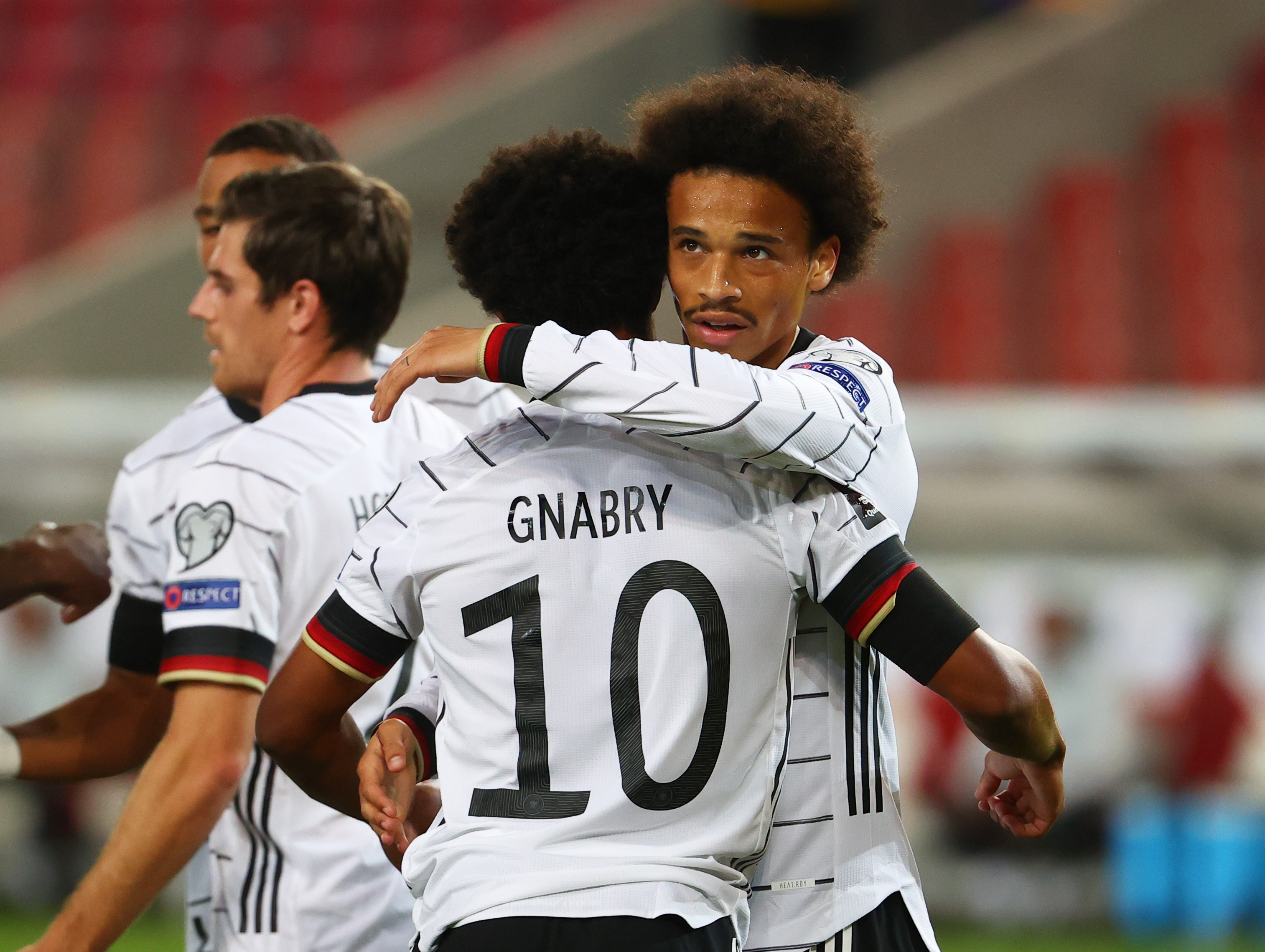 Soccer Football - World Cup - UEFA Qualifiers - Group J - Germany v Armenia - Mercedes-Benz Arena, Stuttgart, Germany - September 5, 2021  Germany's Serge Gnabry celebrates scoring their second goal with Leroy Sane REUTERS/Kai Pfaffenbach